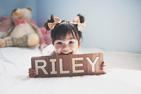 Spell Well Name Puzzle handmade wooden toy for one year olds Smiling Tree Toys @rileyandchayce