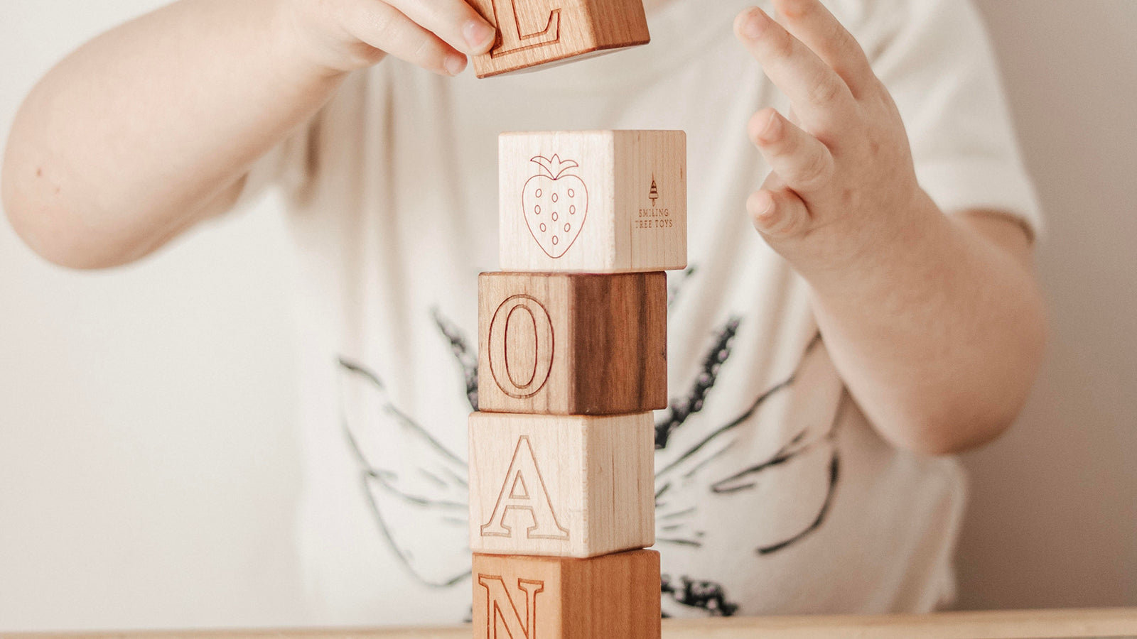 wooden letter name blocks in natural woods with uppercase and pictures