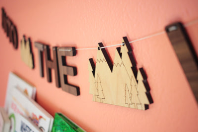 toddler bedroom and playroom decor - into the wild wall hanging