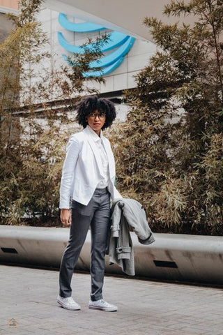 beautiful woman standing outside wearing business professional clothing and natural hair