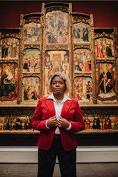 beautiful woman standing in church wearing business professional clothing and natural hair