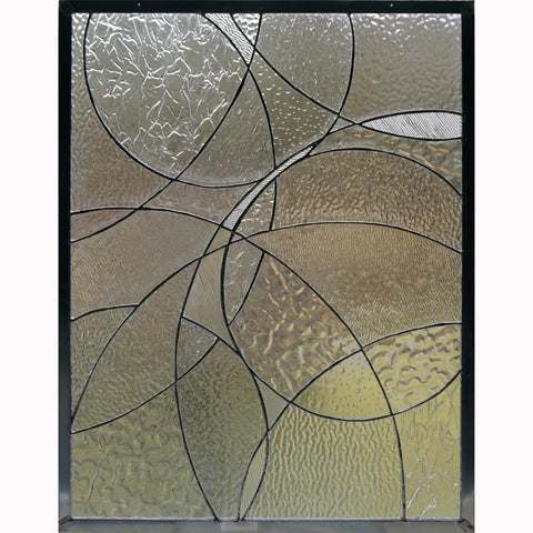 Circle Study 1 combines a variety of clear texture stained glass in an abstract window designed and created by Jill Tarabar for JiSTdesigns