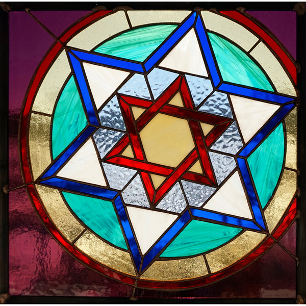 Synagoga Tempel art glass window inspired by stained glass window that survived World War II in Polish synagogue