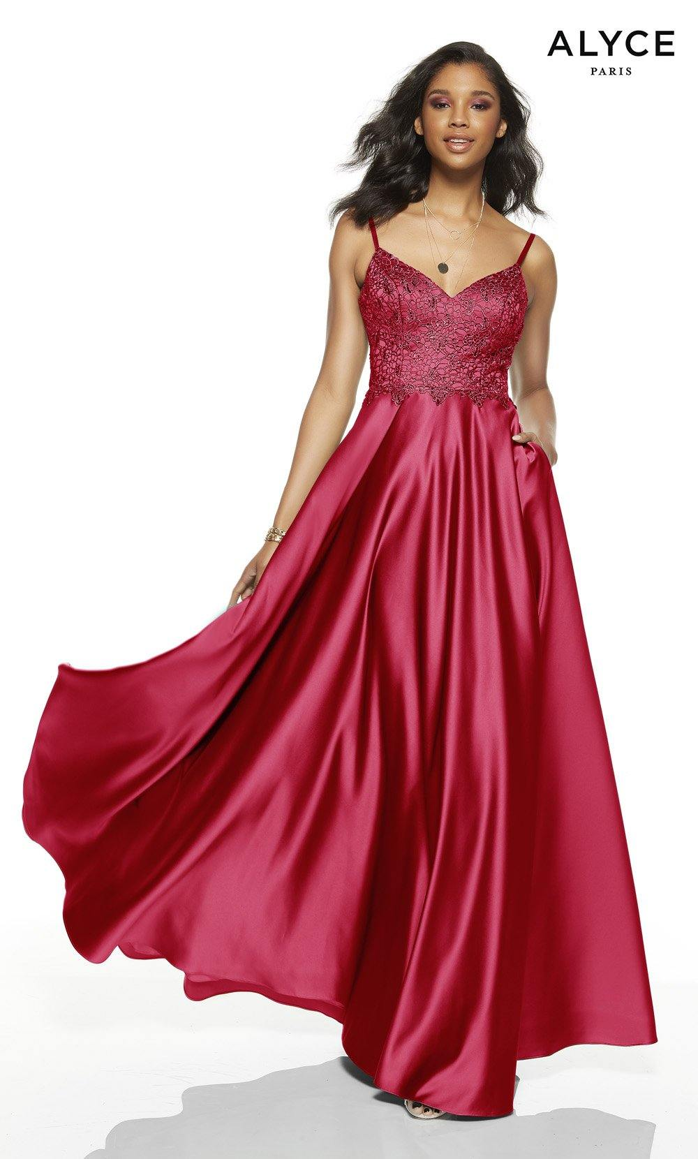 Red formal dress with a v-neckline and pockets
