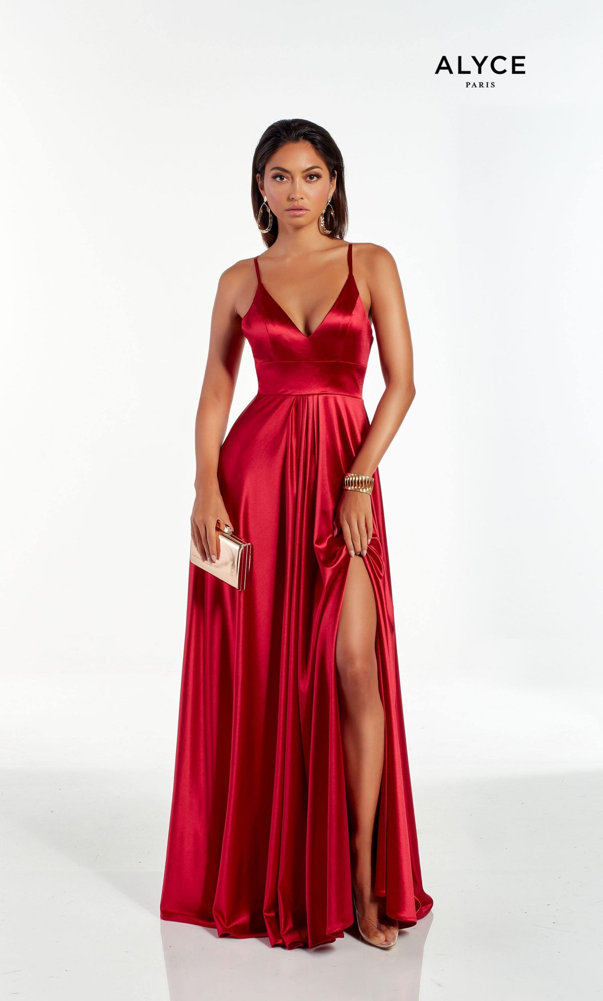 Red flowy satin formal dress with a V shaped neckline and a front slit