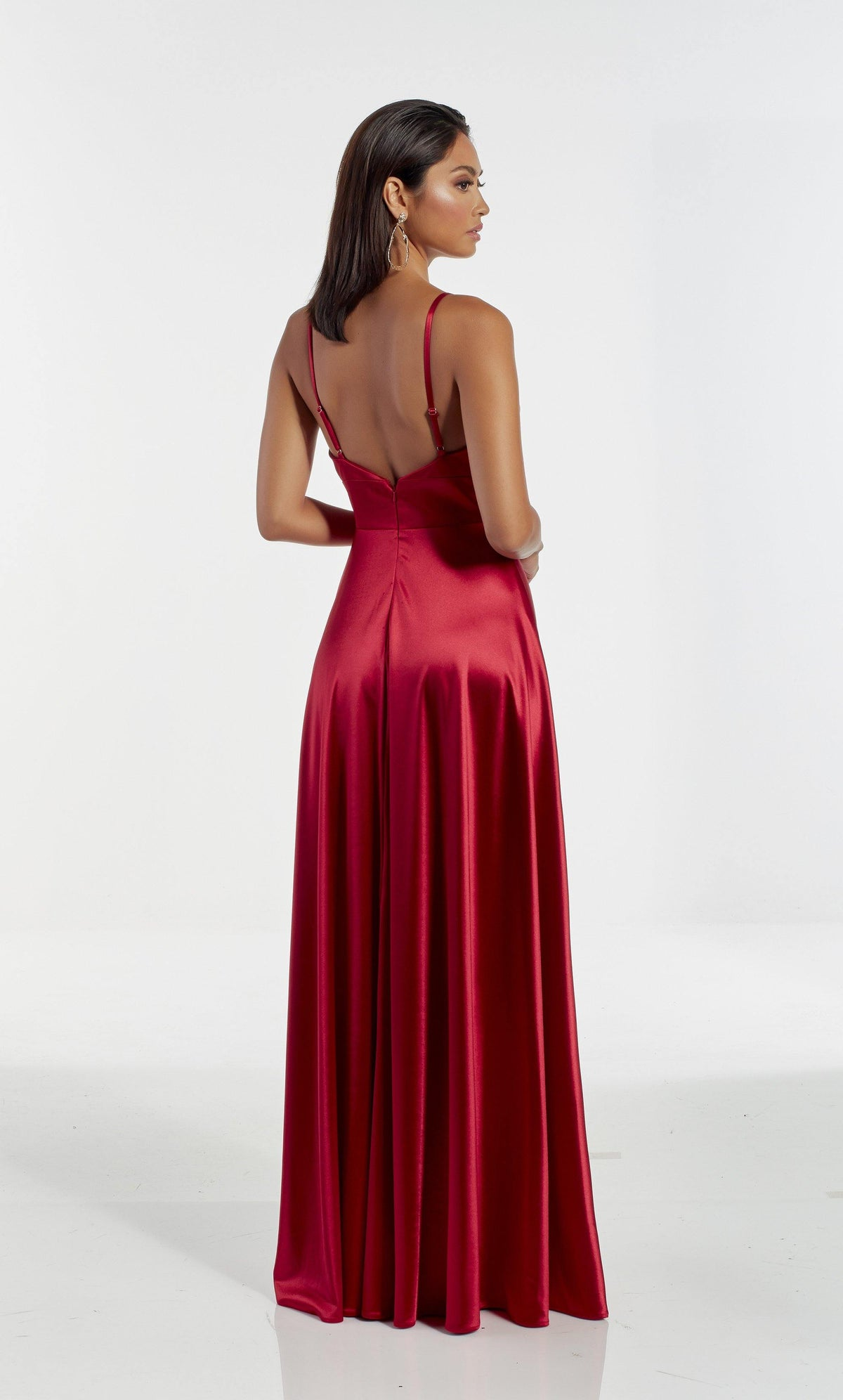 Red flowy satin formal dress with an open back and adjustable straps