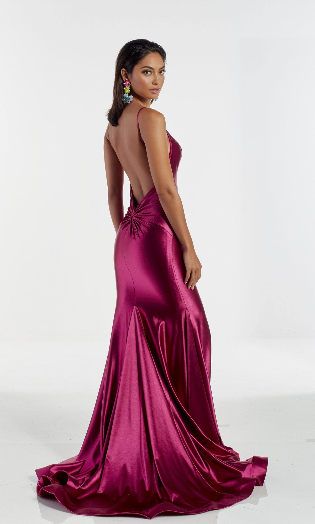 Pink satin evening dress with an open back and train