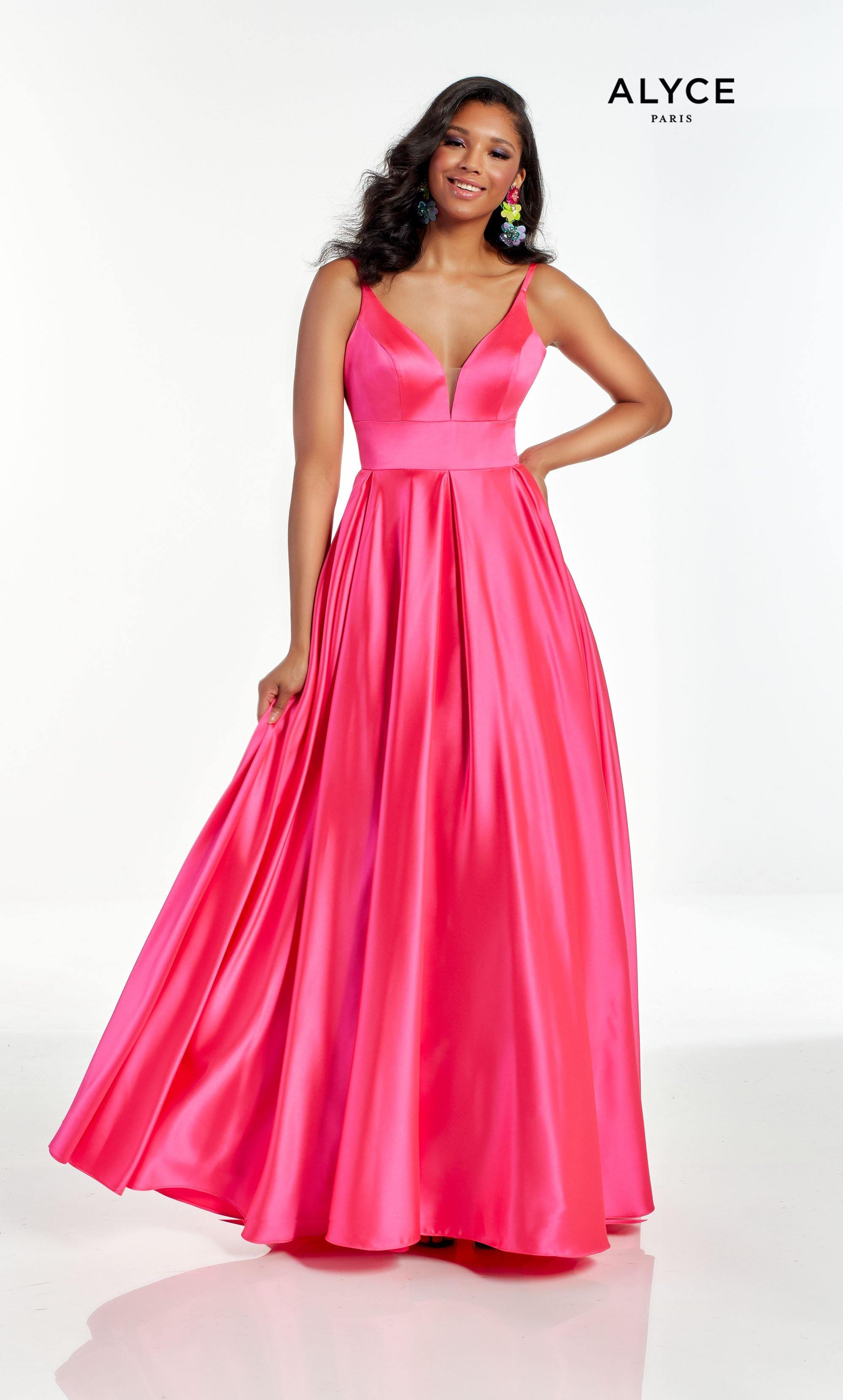 Barbie Pink wedding guest dress with a plunging neckline and pockets