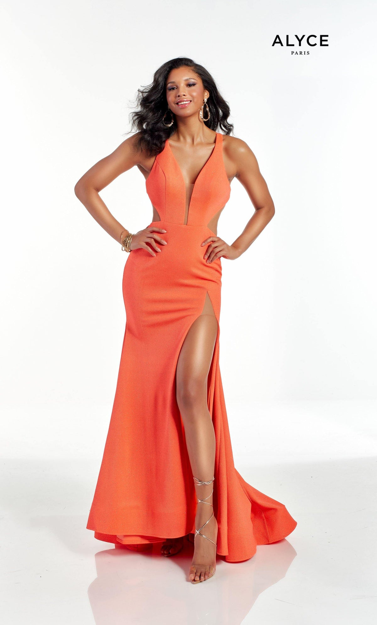 Orange formal dress with a plunging neckline and a front slit