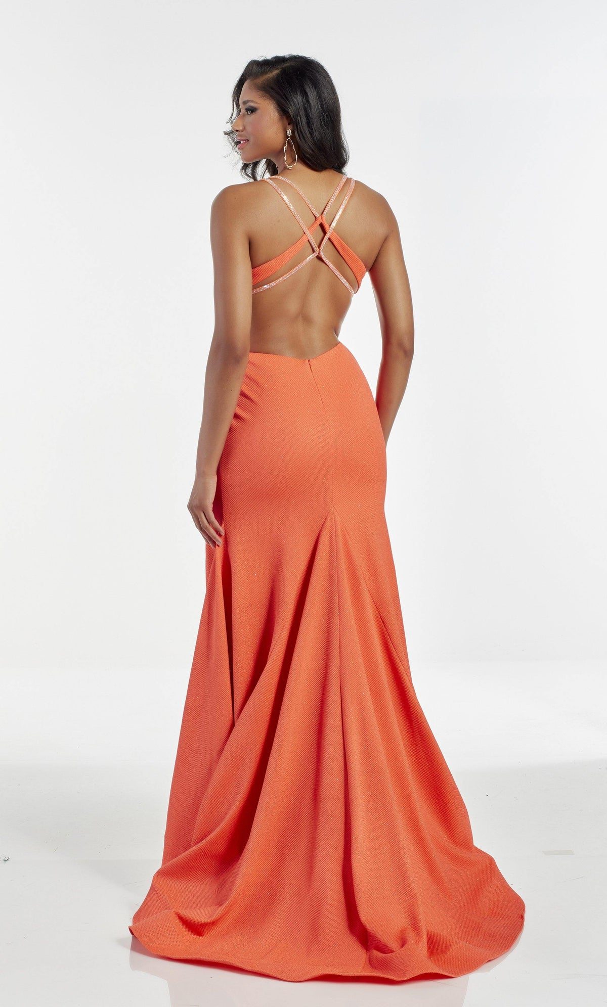 Orange formal dress with a strappy open back and train