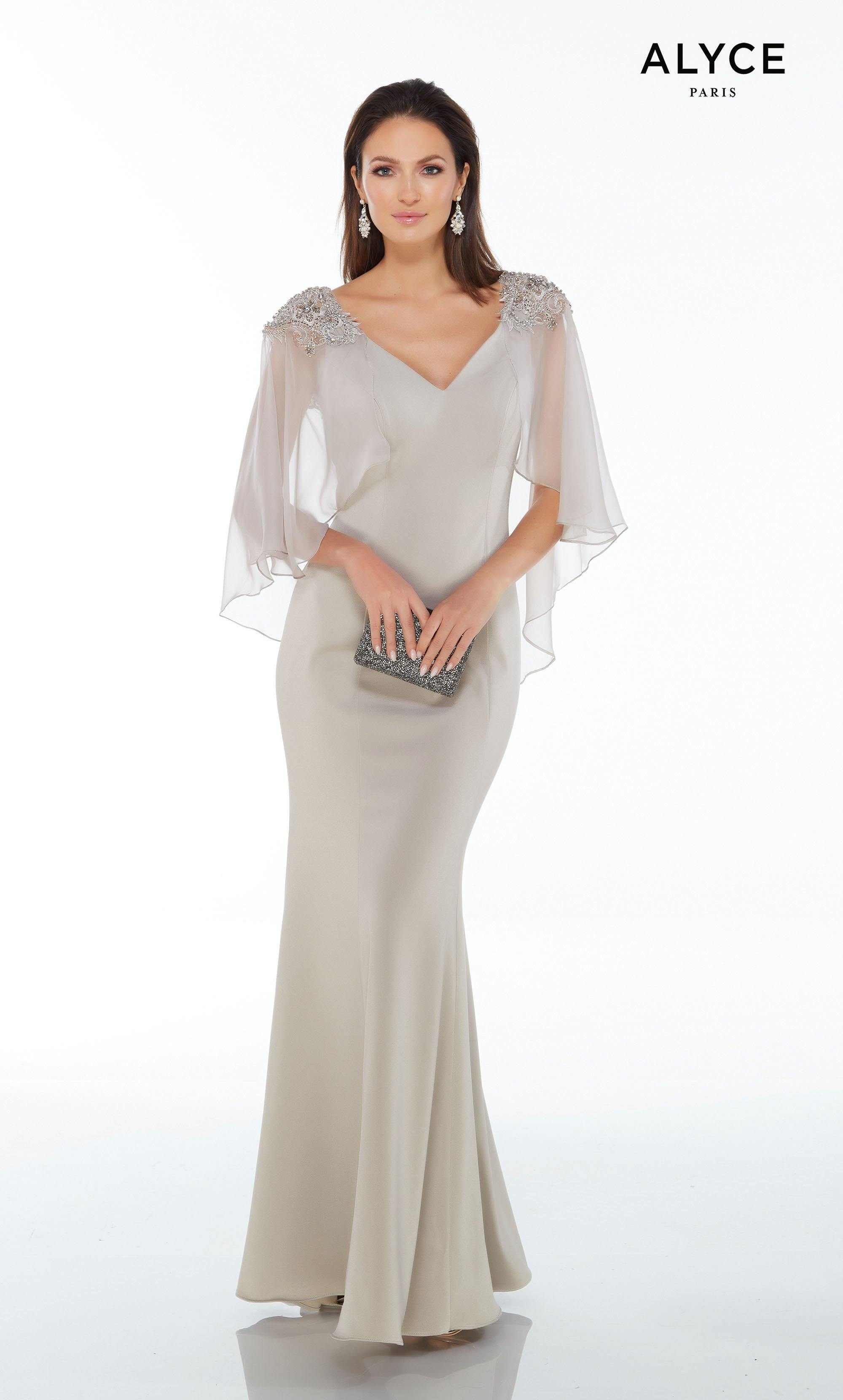 Silver stretch crepe dress with a V-neckline, flowy chiffon sleeves and beading on the shoulder and throughout the V-shaped back