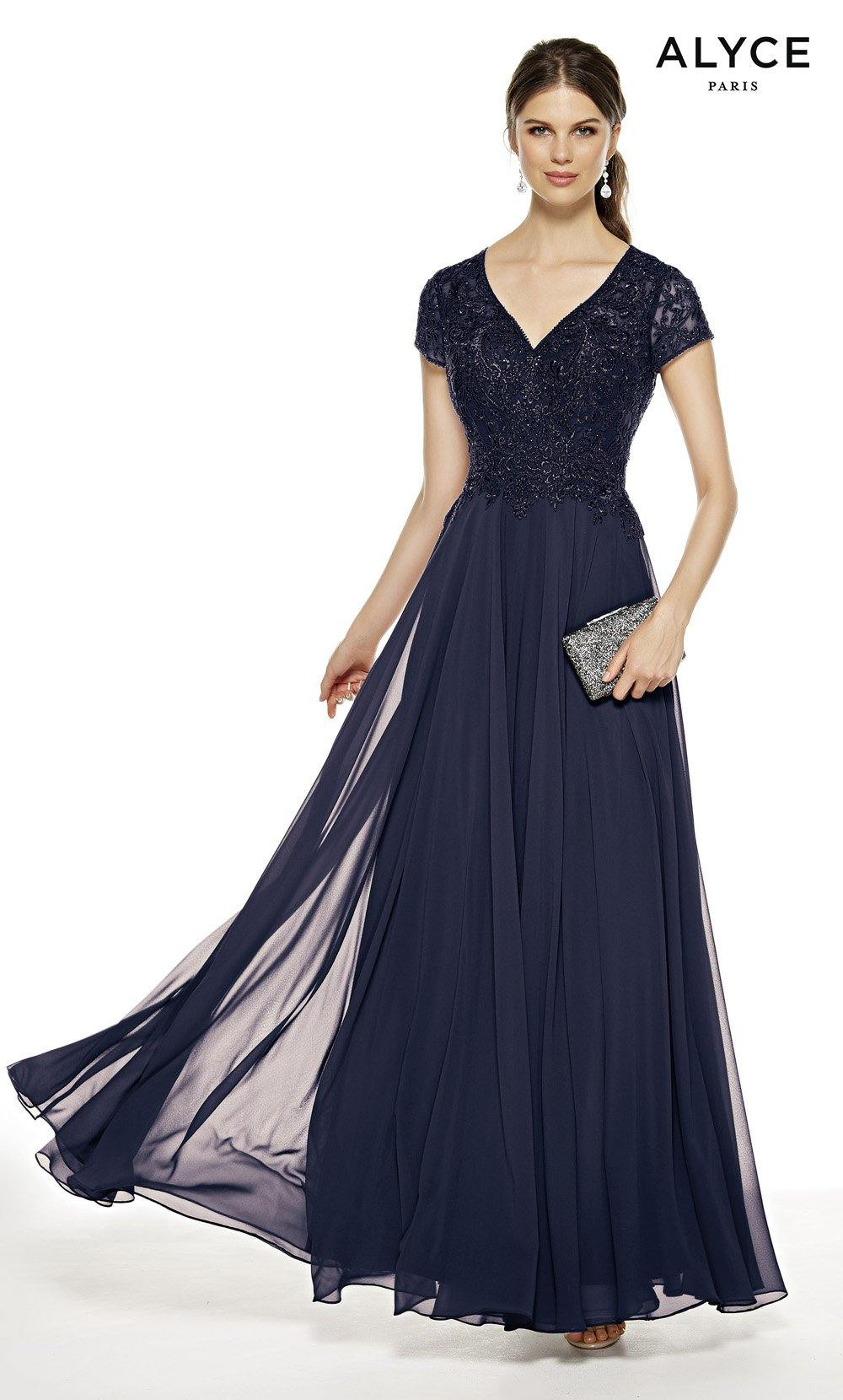 Navy flowy wedding guest dress with a V-neck and short sleeves