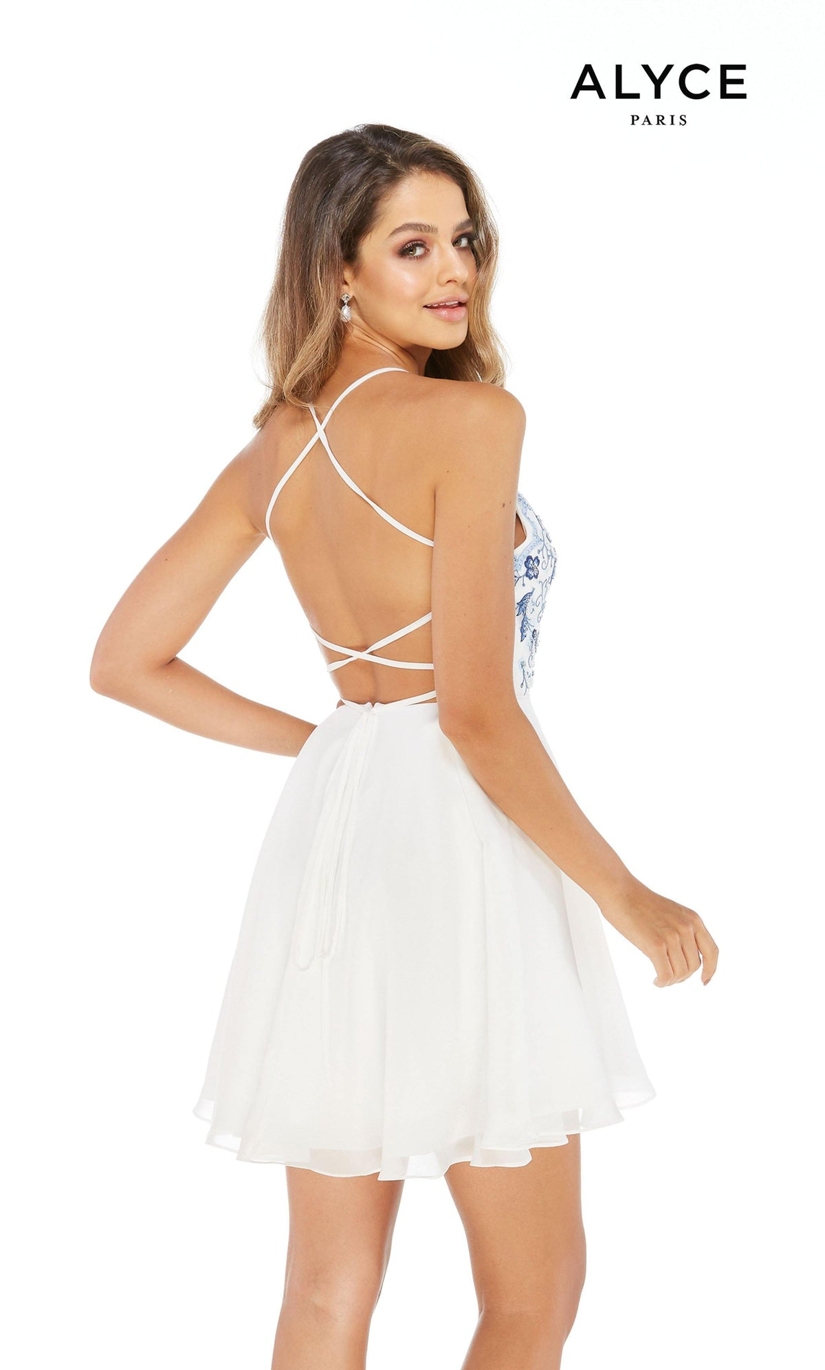 Short white graduation dress with blue floral embroidery on the top and a strappy back