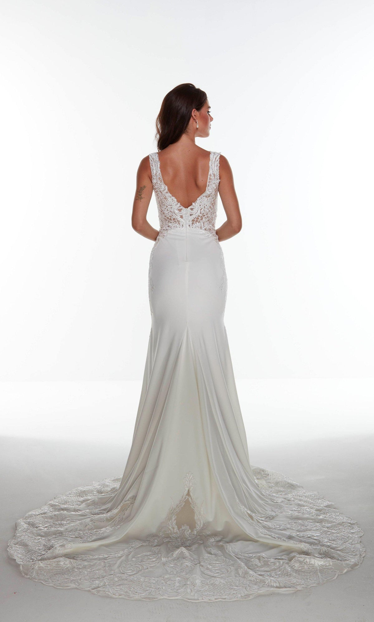Long Ivory stretch crepe informal bridal gown with a V shaped back and stone embellished lace detail