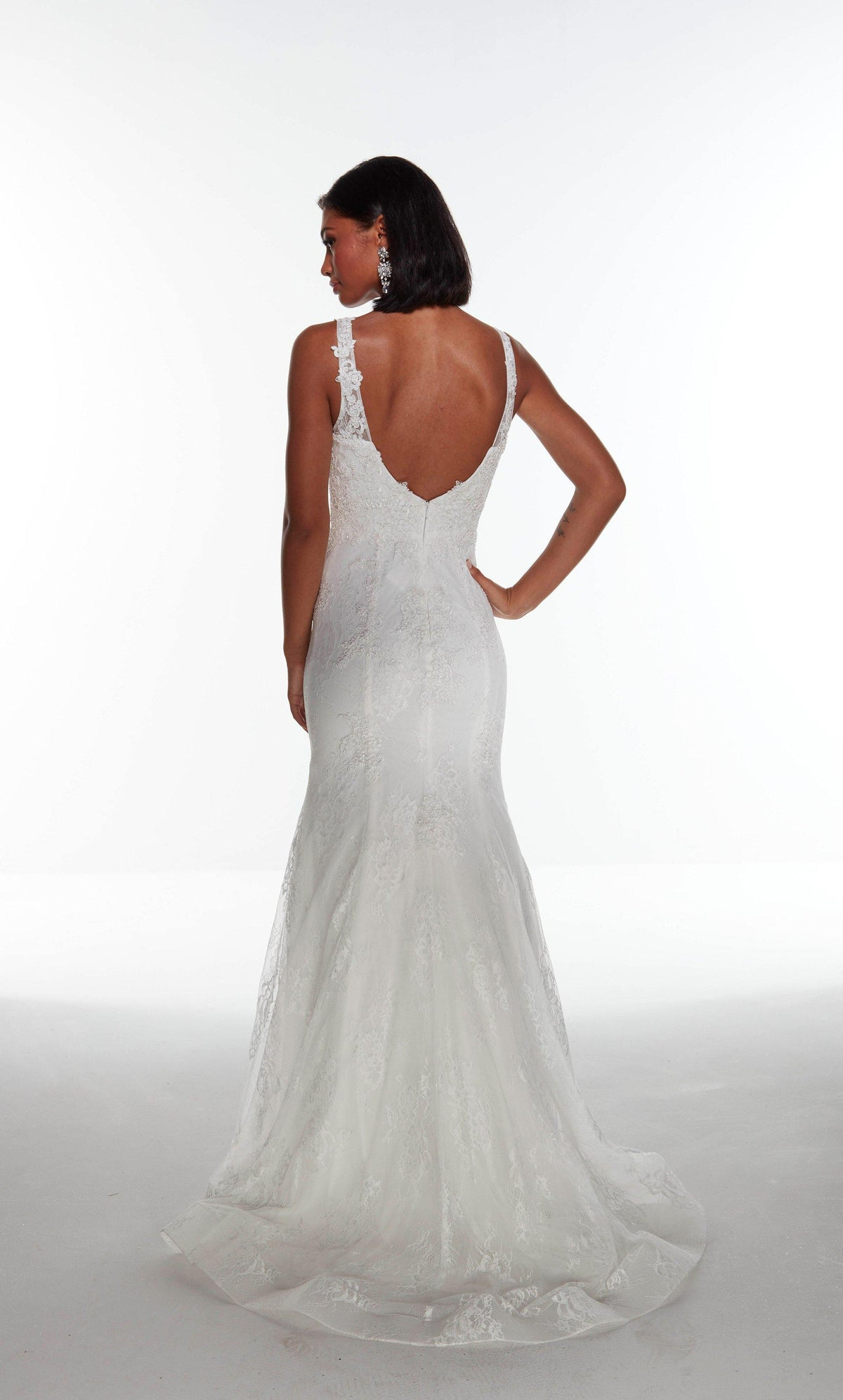 Diamond White lace mermaid style wedding dress with a V shaped back and train