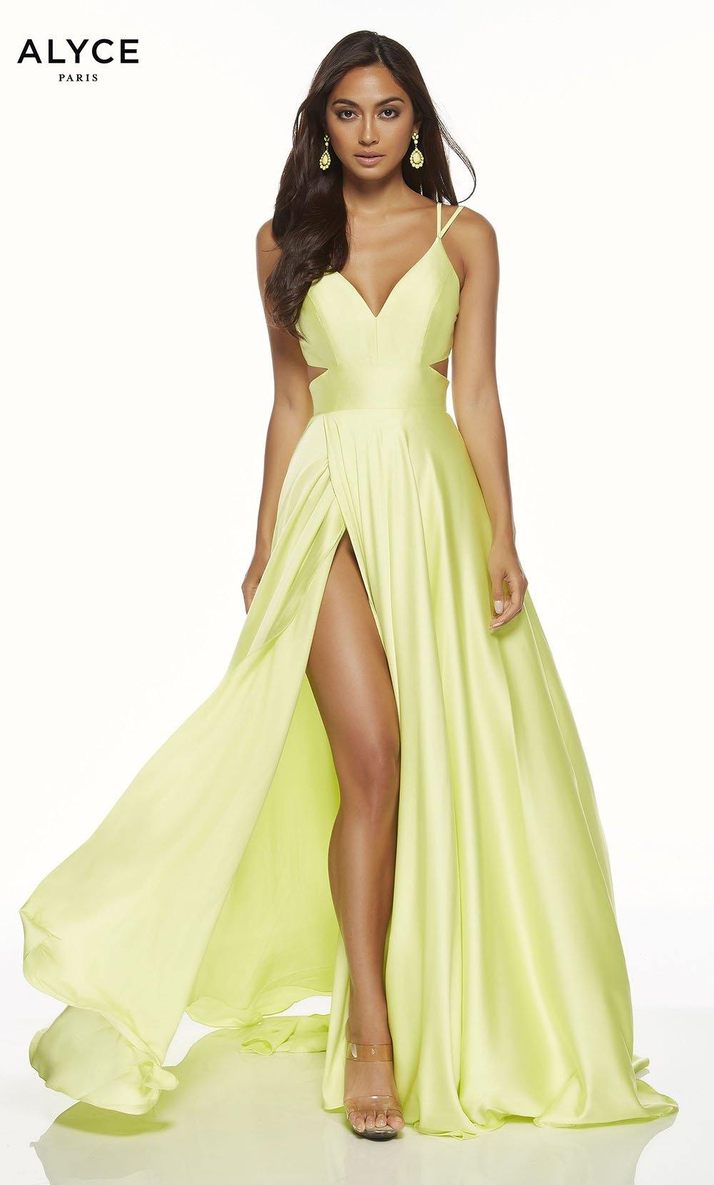Yellow flowy satin chiffon prom dress with a V neck, side cutouts, and front slit