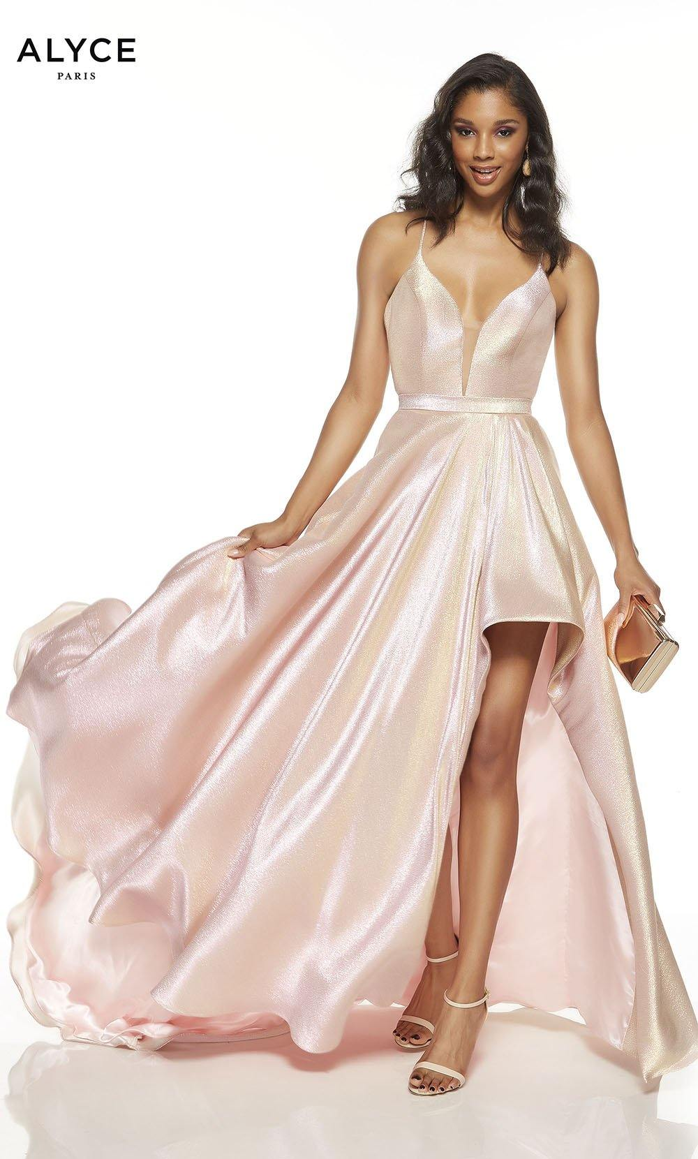 Bubble Gum Pink metallic lame prom dress with a plunging neckline and a slit