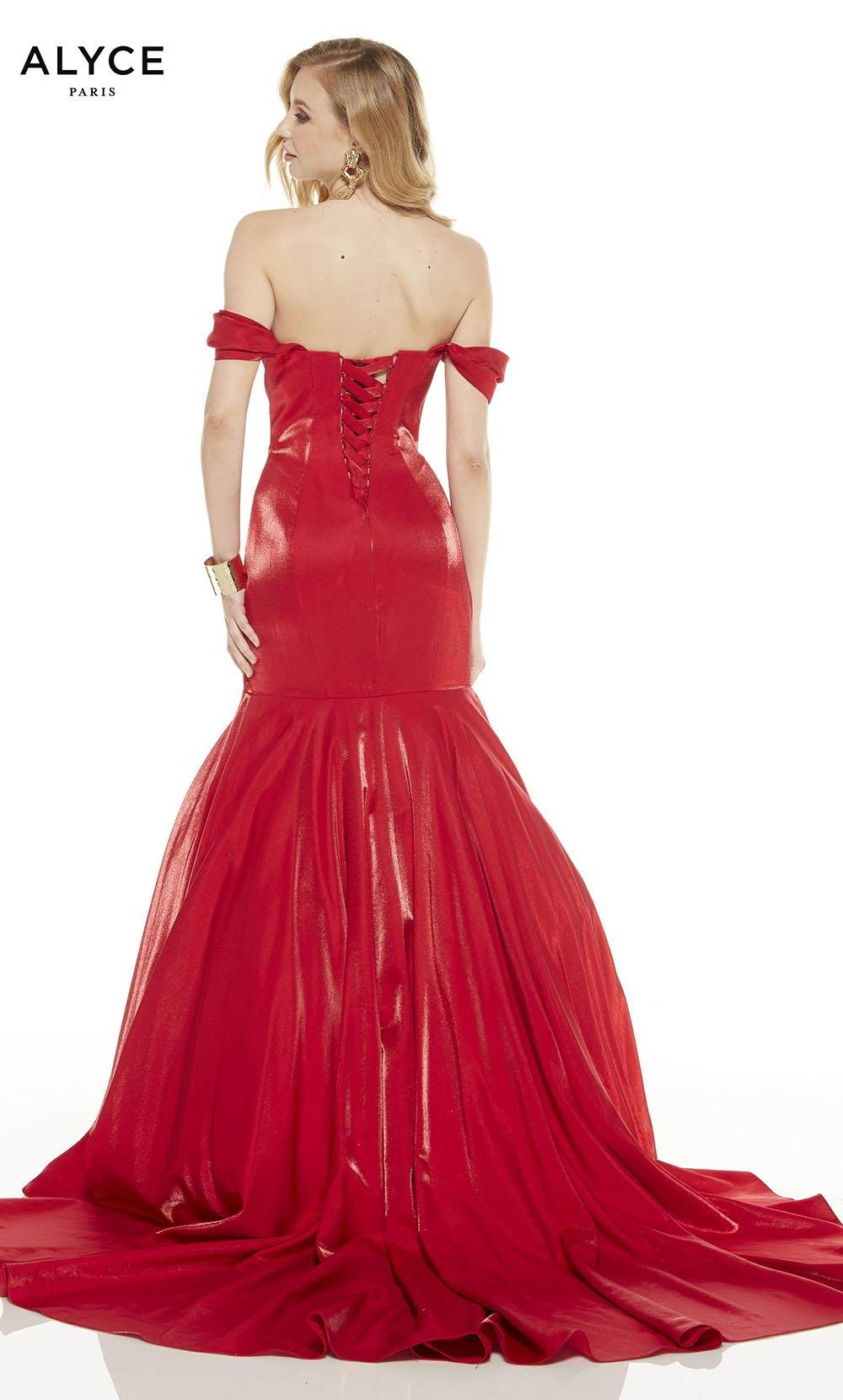 Red mermaid gown with a lace up back and sweep train
