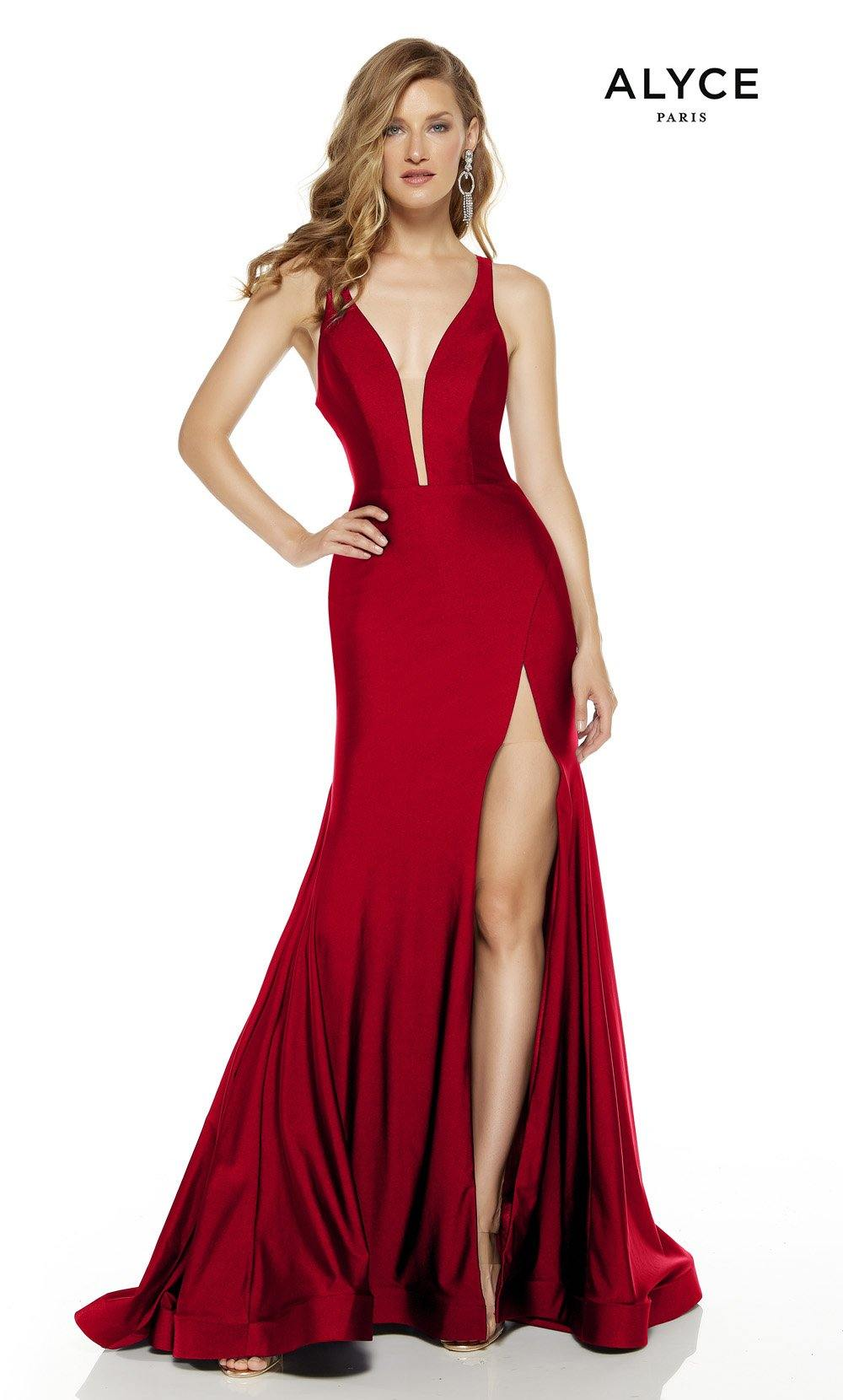 Red prom dress with a plunging neckline and a slit