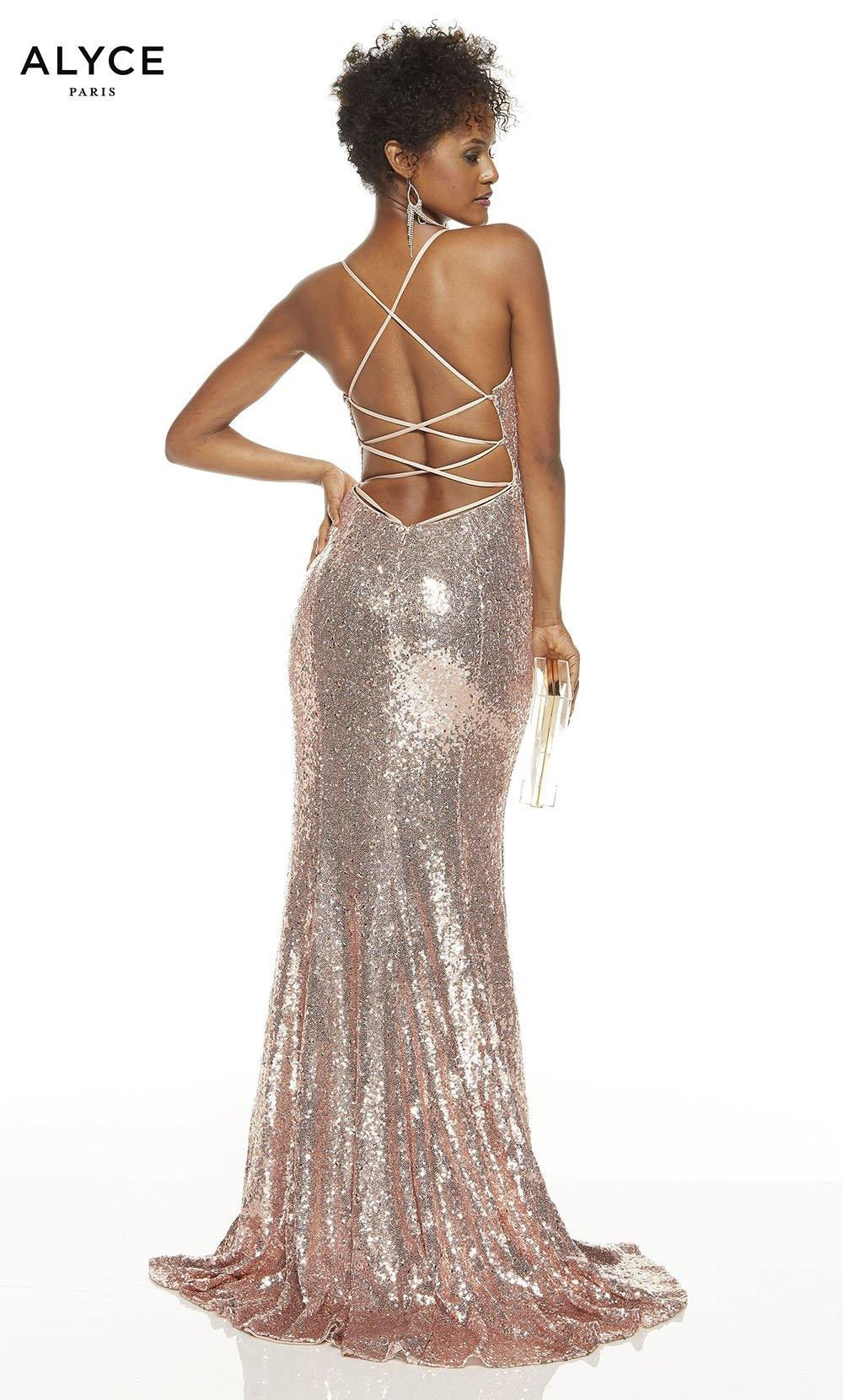 Rose Gold sequin prom dress with a strappy back and a train