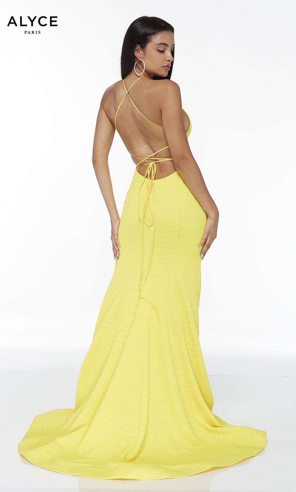 Bright Yellow mermaid dress with a strappy back and a train