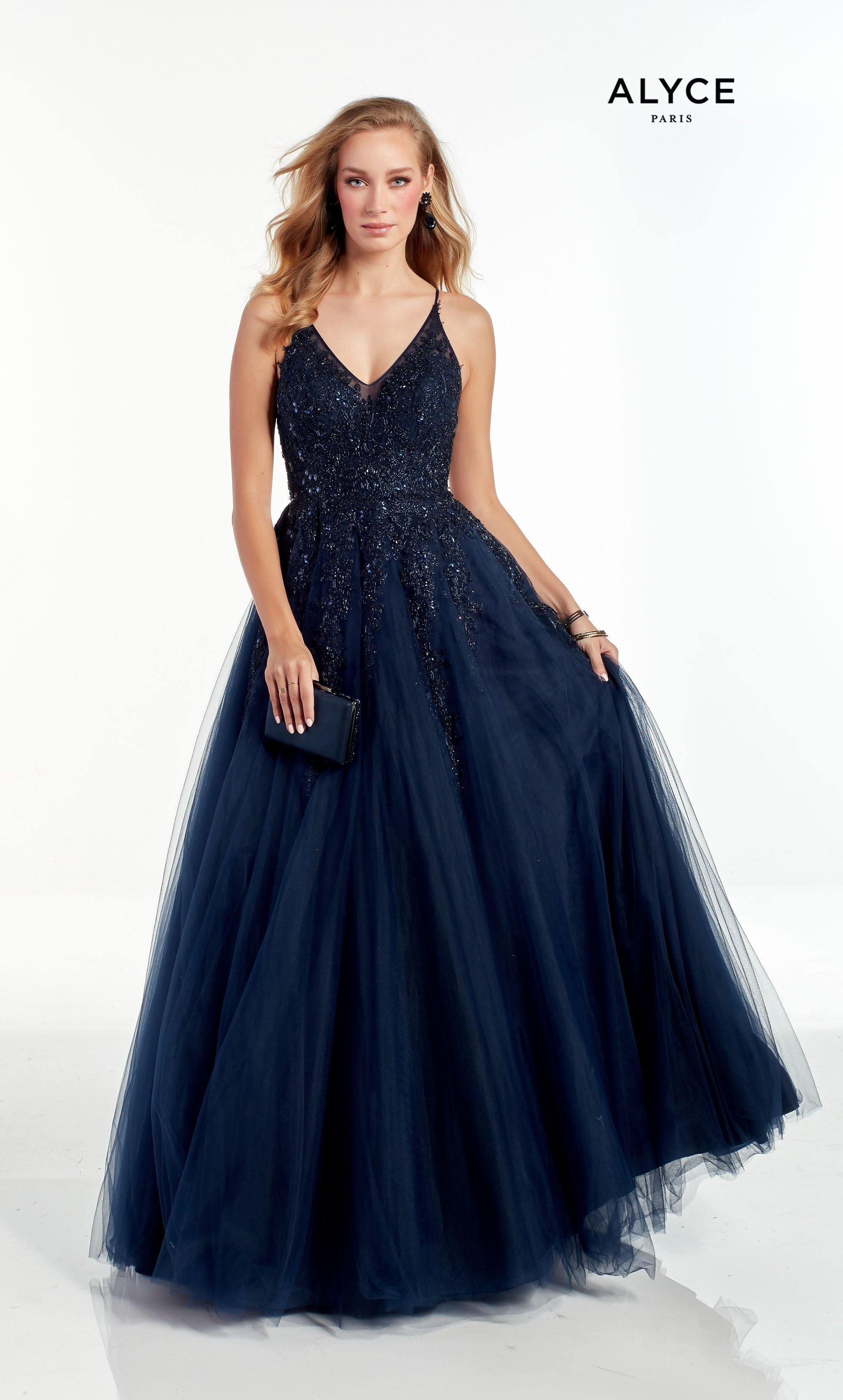 Midnight Blue ballgown with a V neckline and beaded detail