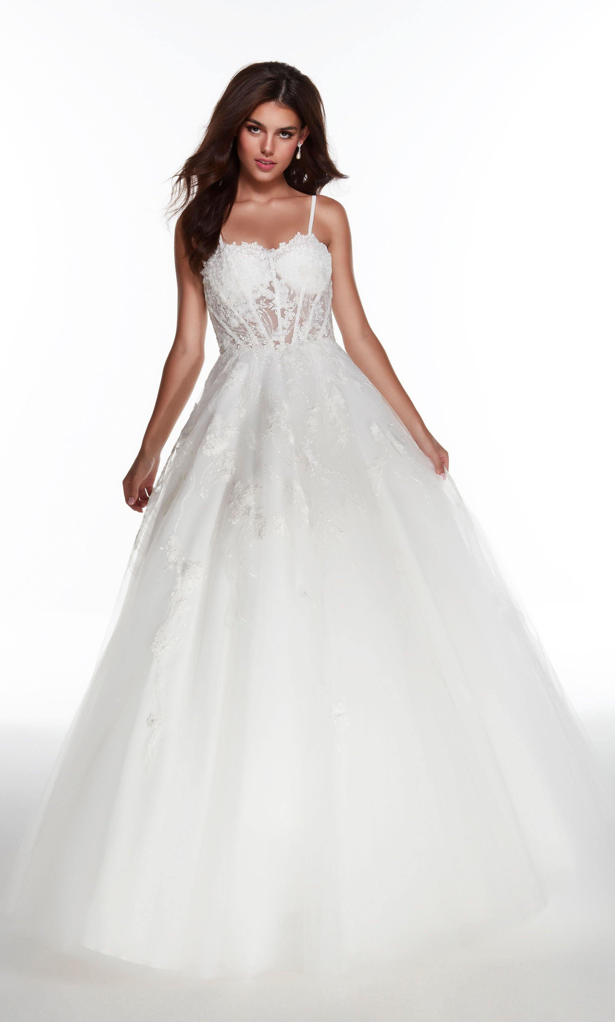 Diamond White ballgown with a sweetheart neckline, sheer bodice, and beaded floral embroidery