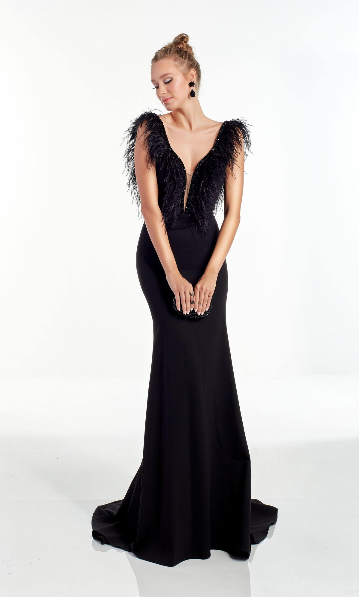 Black evening gown with a plunging, sequin embellished neckline and feather accented bodice