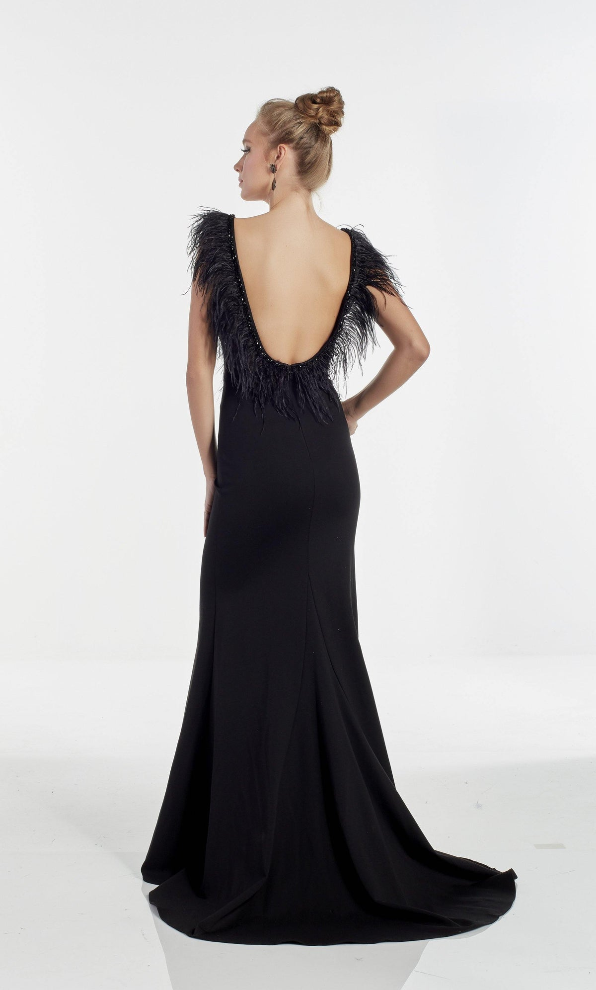 Black evening gown with an open back, feather accented bodice, and train