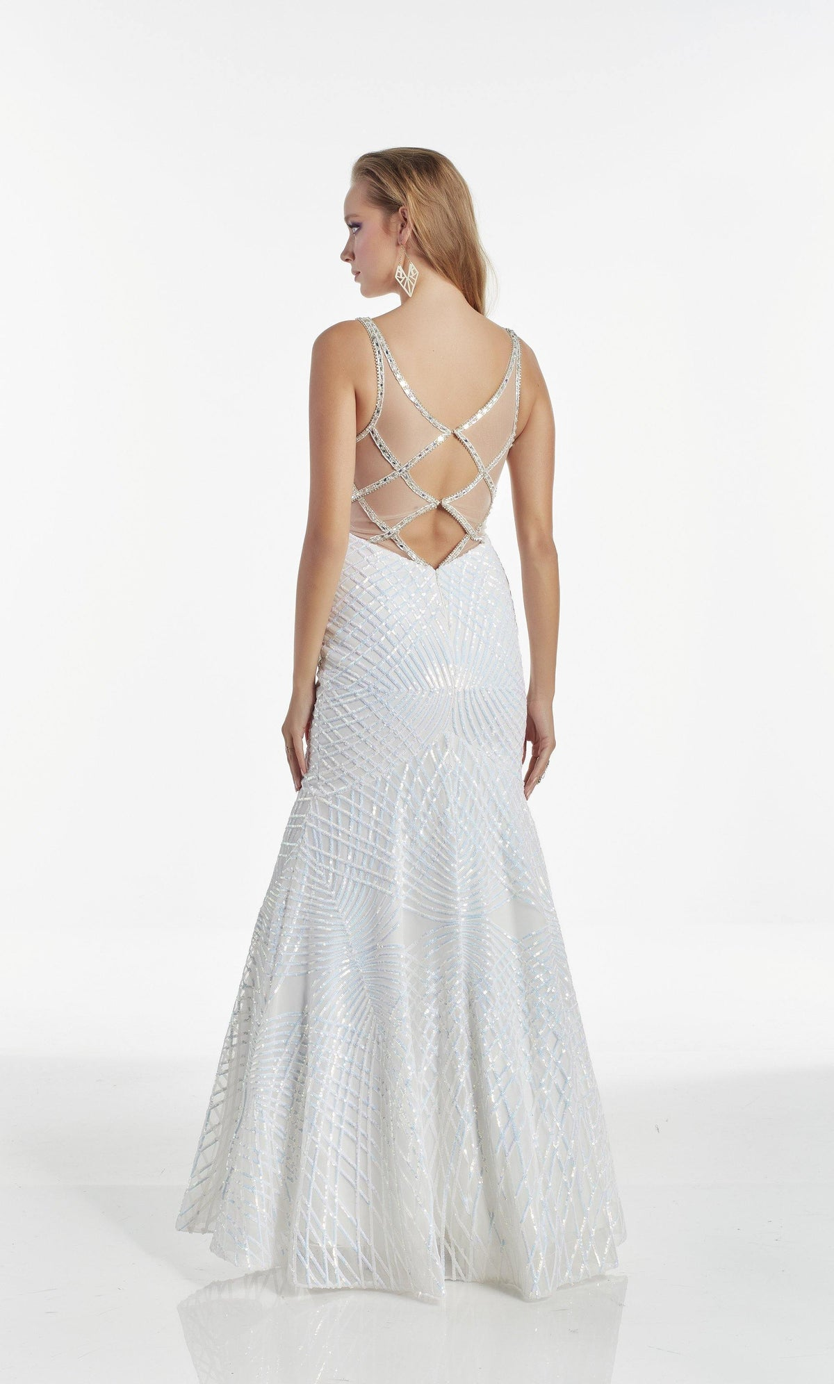 White Opal mermaid pageant dress featuring a keyhole back and fully embellished with iridescent sequins, beads, and stones