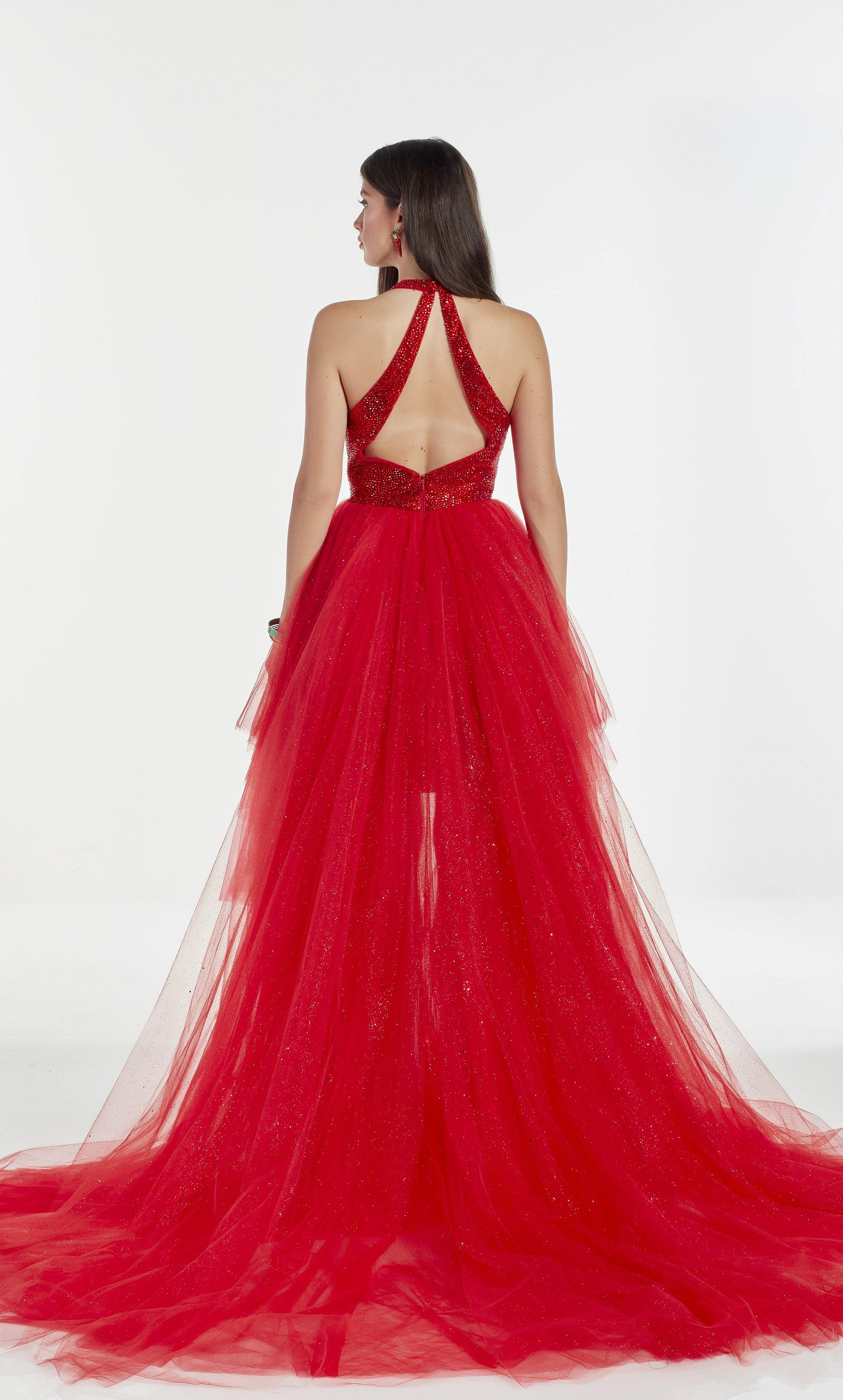 Red glitter tulle high-low prom dress with an adjustable plunging neckline and heat set stone embellished bodice