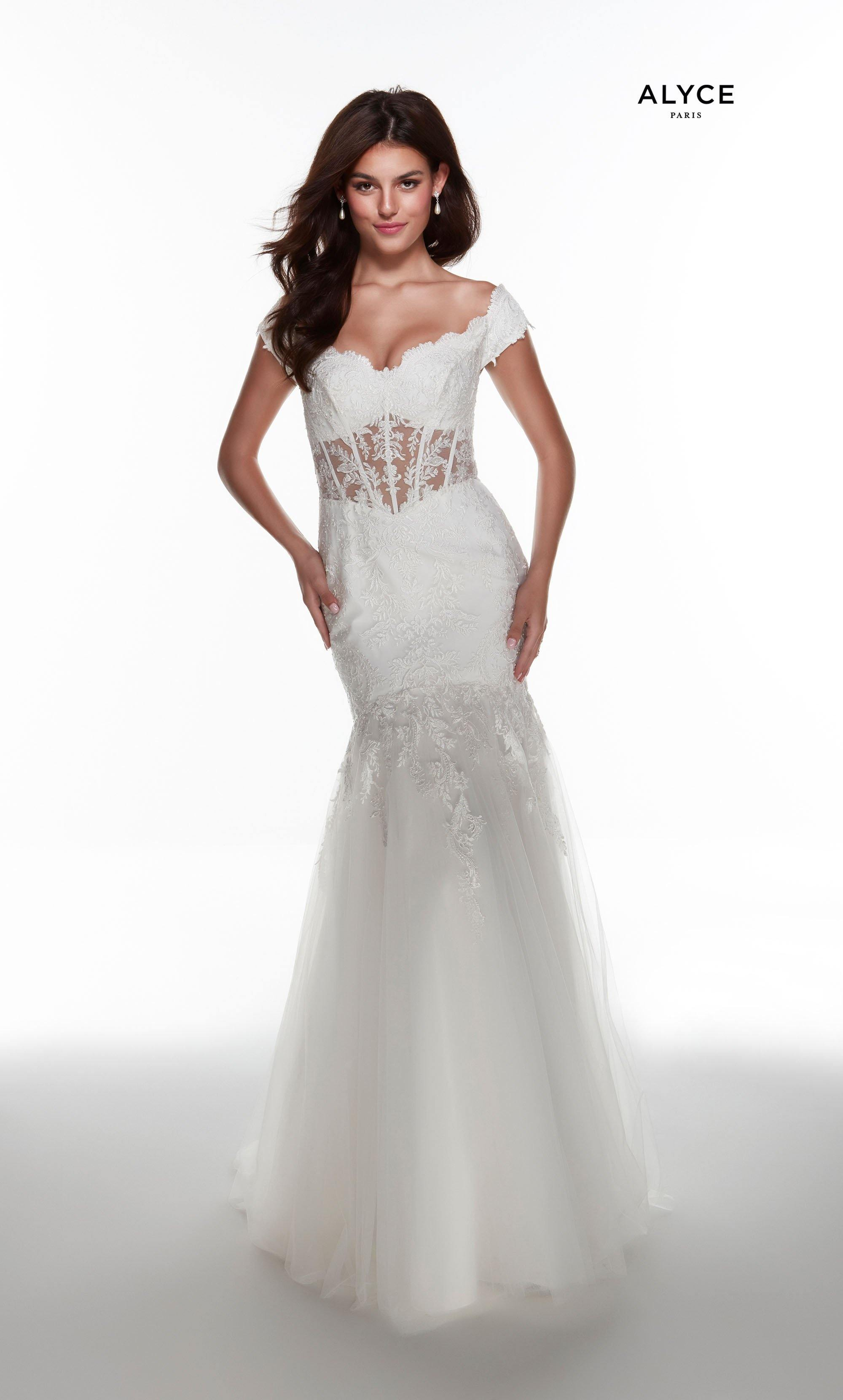 Off the shoulder Ivory mermaid bridal gown with a sheer lace bodice and tulle skirt