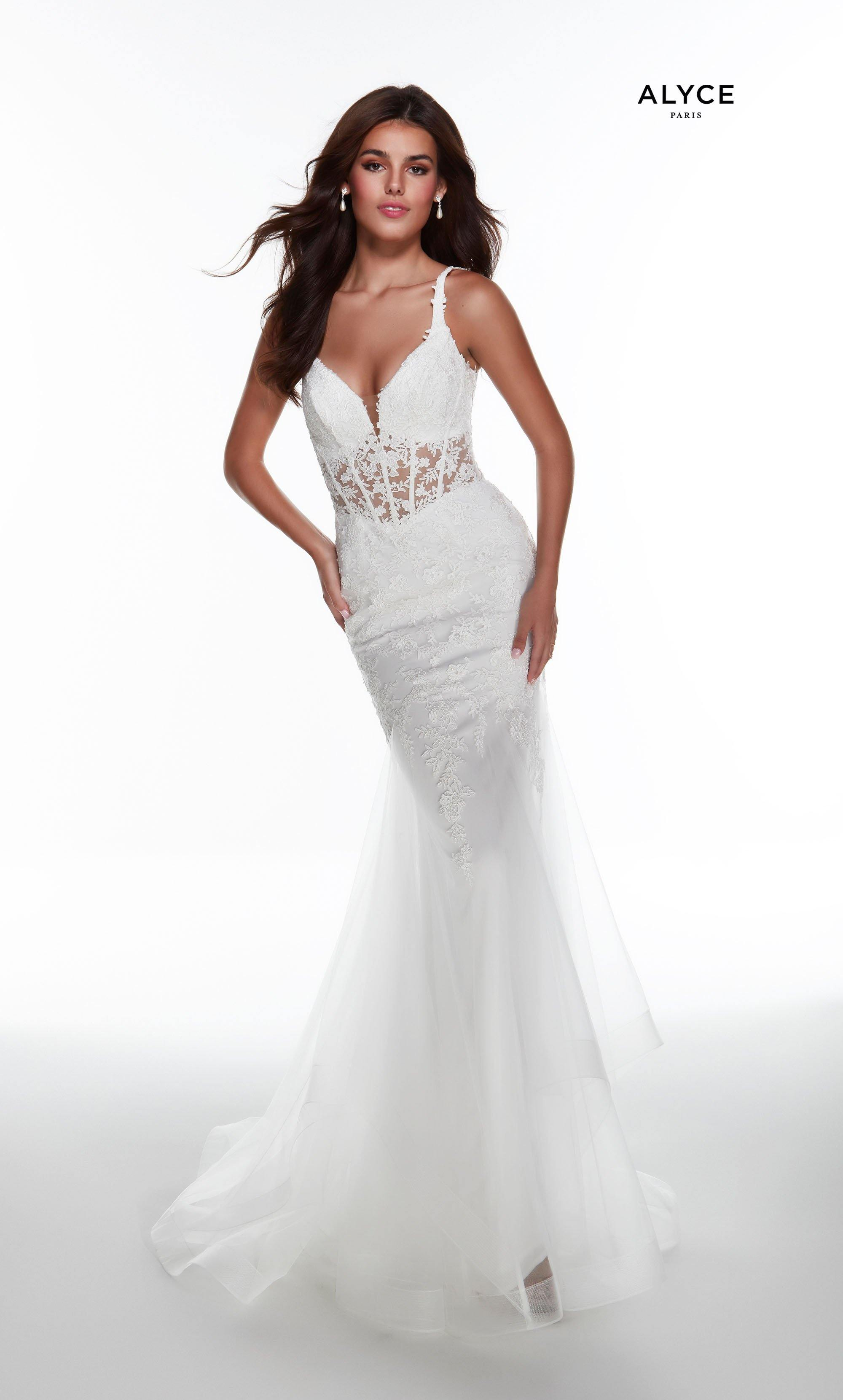 Solid Ivory mermaid wedding dress with a plunging neckline, sheer lace accents, and layered tulle skirt