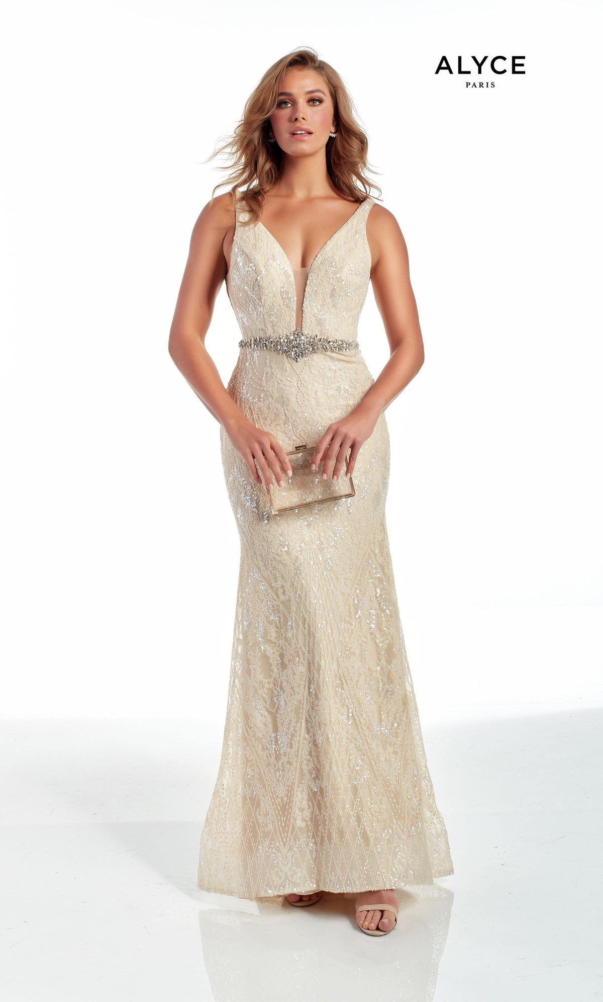 Fully sequin embellished Creme colored evening gown with a plunging neckline and a jewel accents at the natural waist