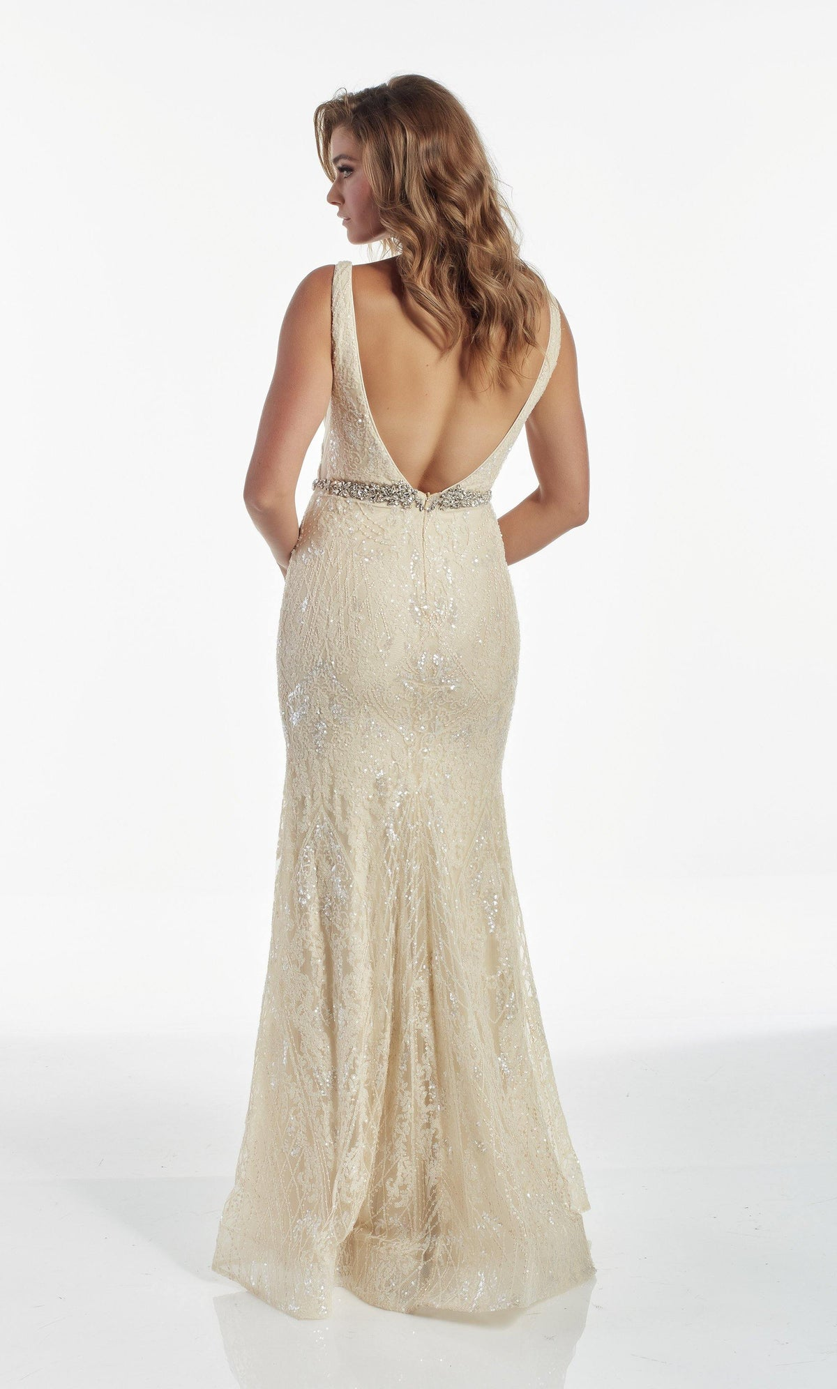 Fully sequin embellished Creme colored evening gown with a V shaped back and a jewel accents at the natural waist