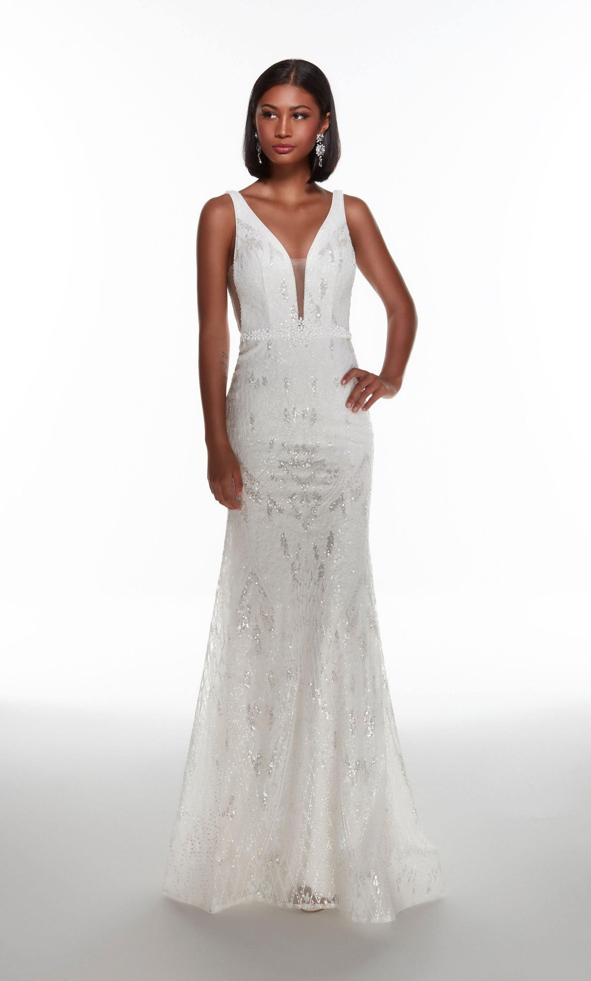 Fully sequin embellished Diamond White colored wedding gown with a plunging neckline and a jewel accents at the natural waist