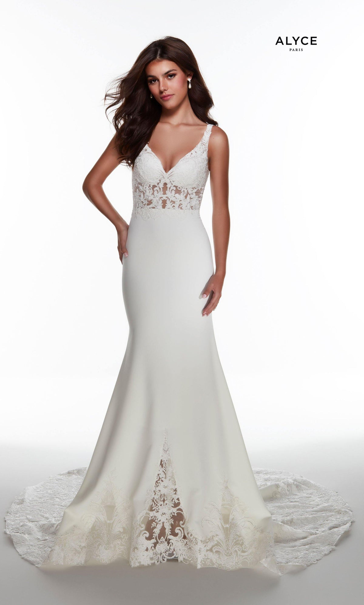 Ivory mermaid wedding dress with a V neckline and sheer lace accents