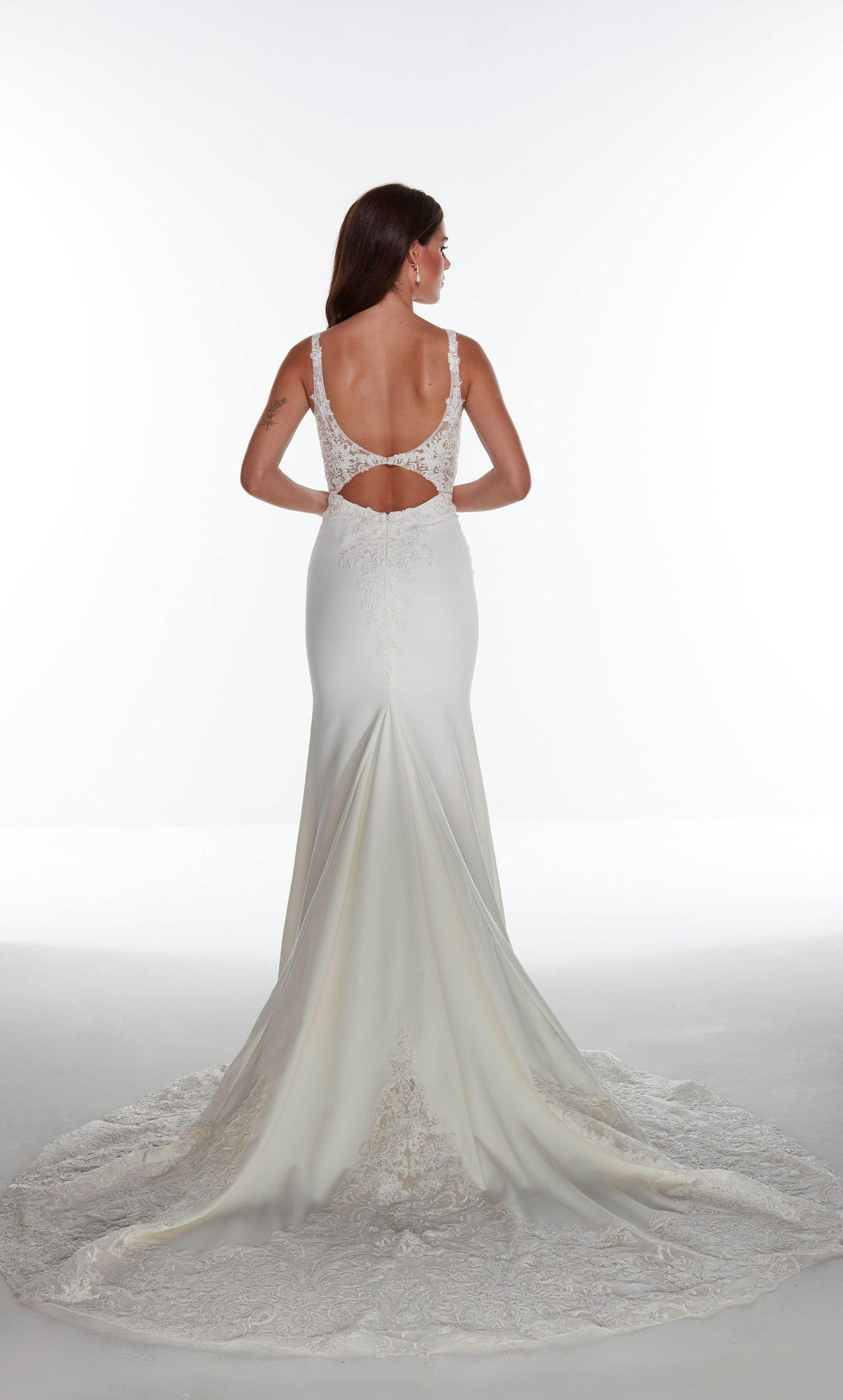Ivory mermaid evening gown with a keyhole back, sheer lace accents, and train