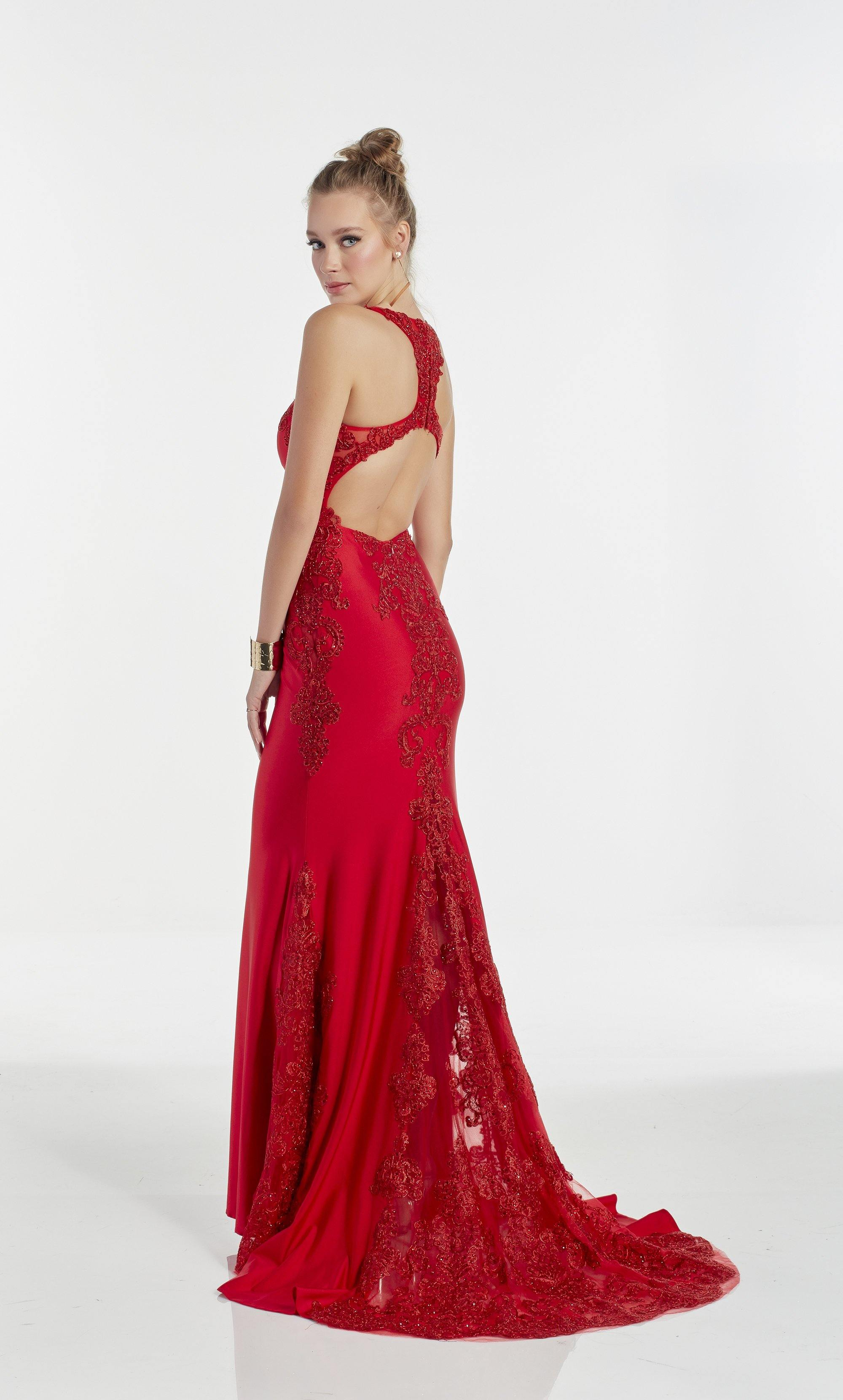 Red fit and flare slinky prom dress with a scoop neckline and sheer lace accents