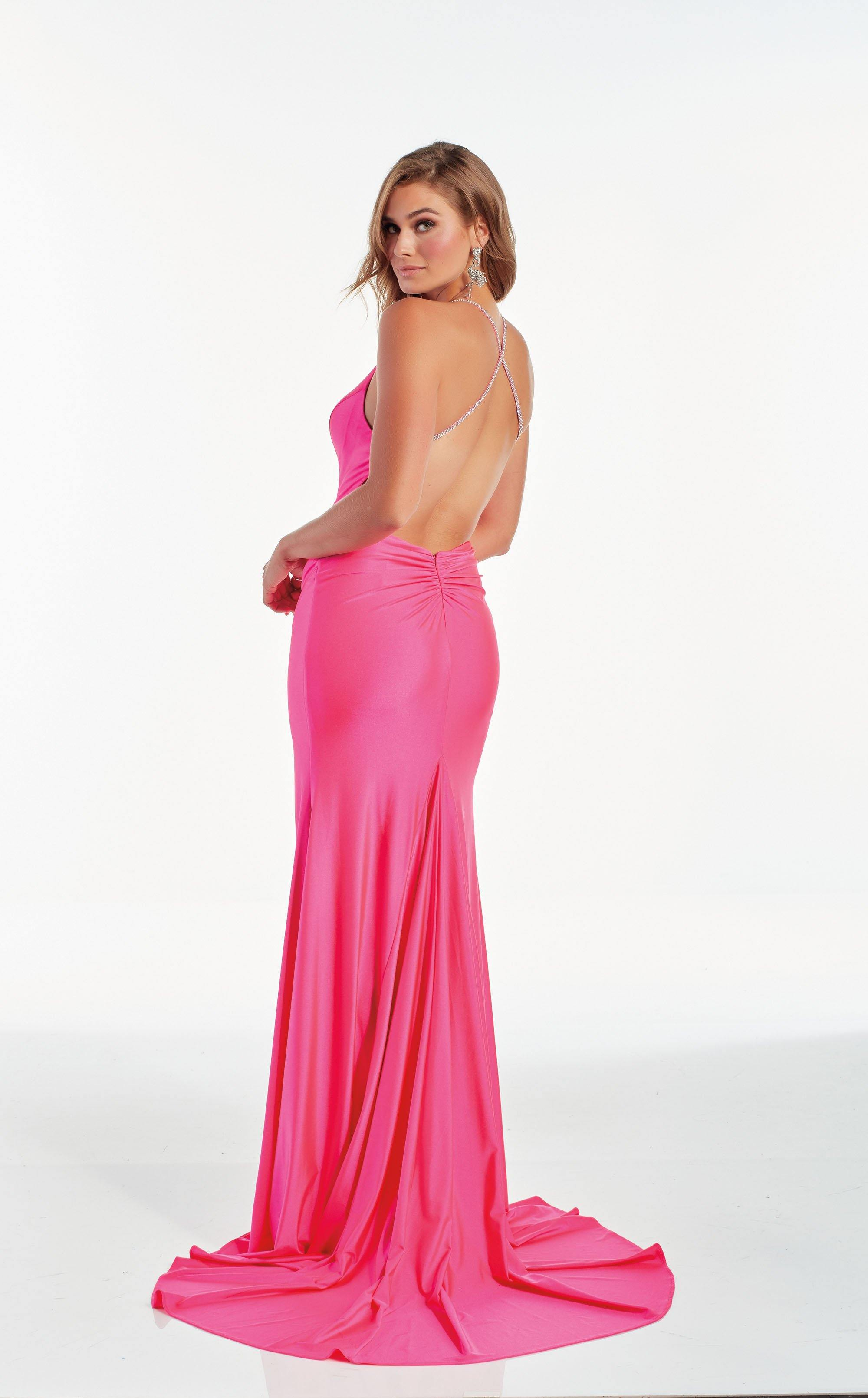 Barbie Pink slinky prom dress with a V neckline, stone embellished straps, and high slit