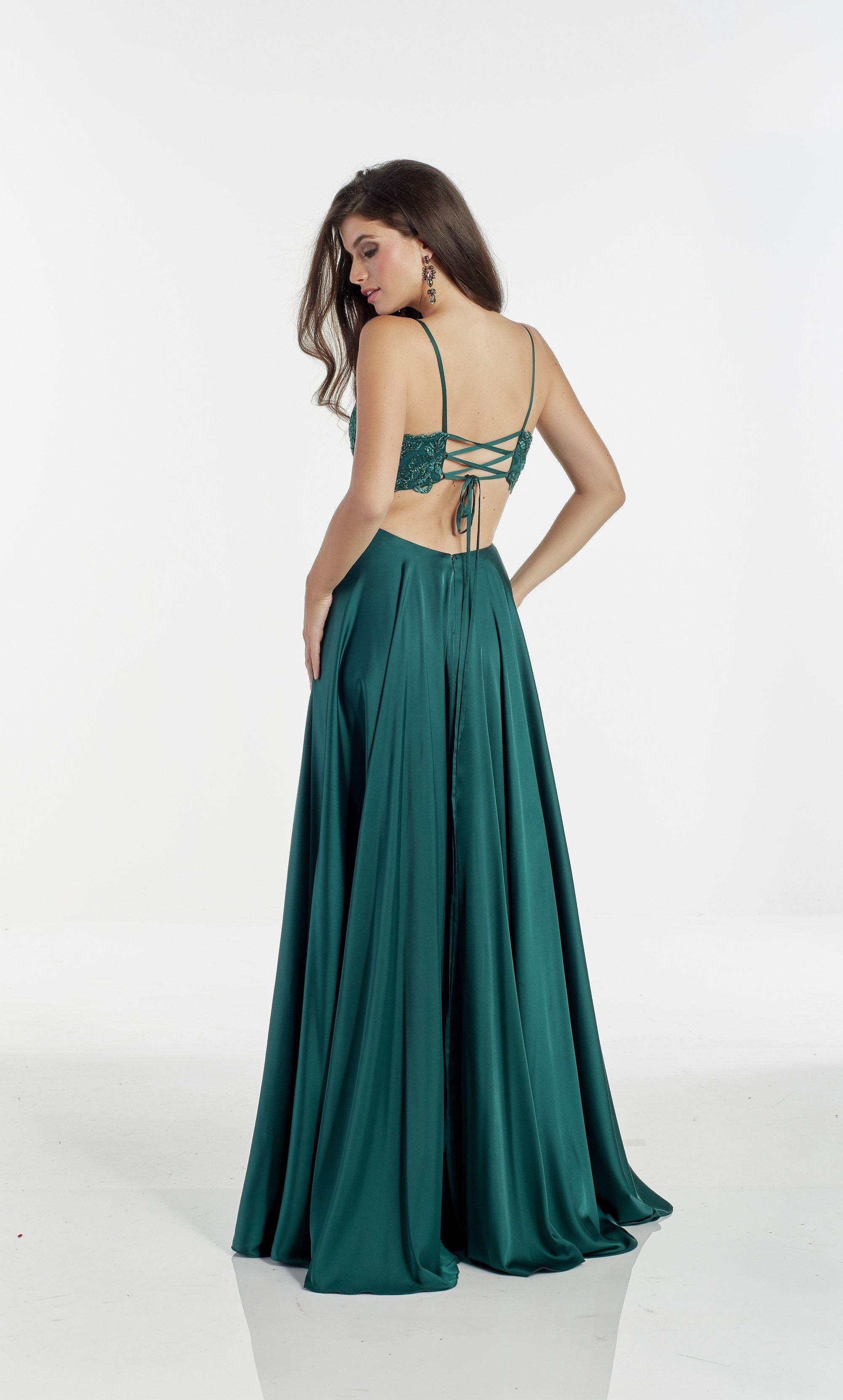Pine flowy bridesmaid dress with a plunging neckline, lace bodice, and front slit