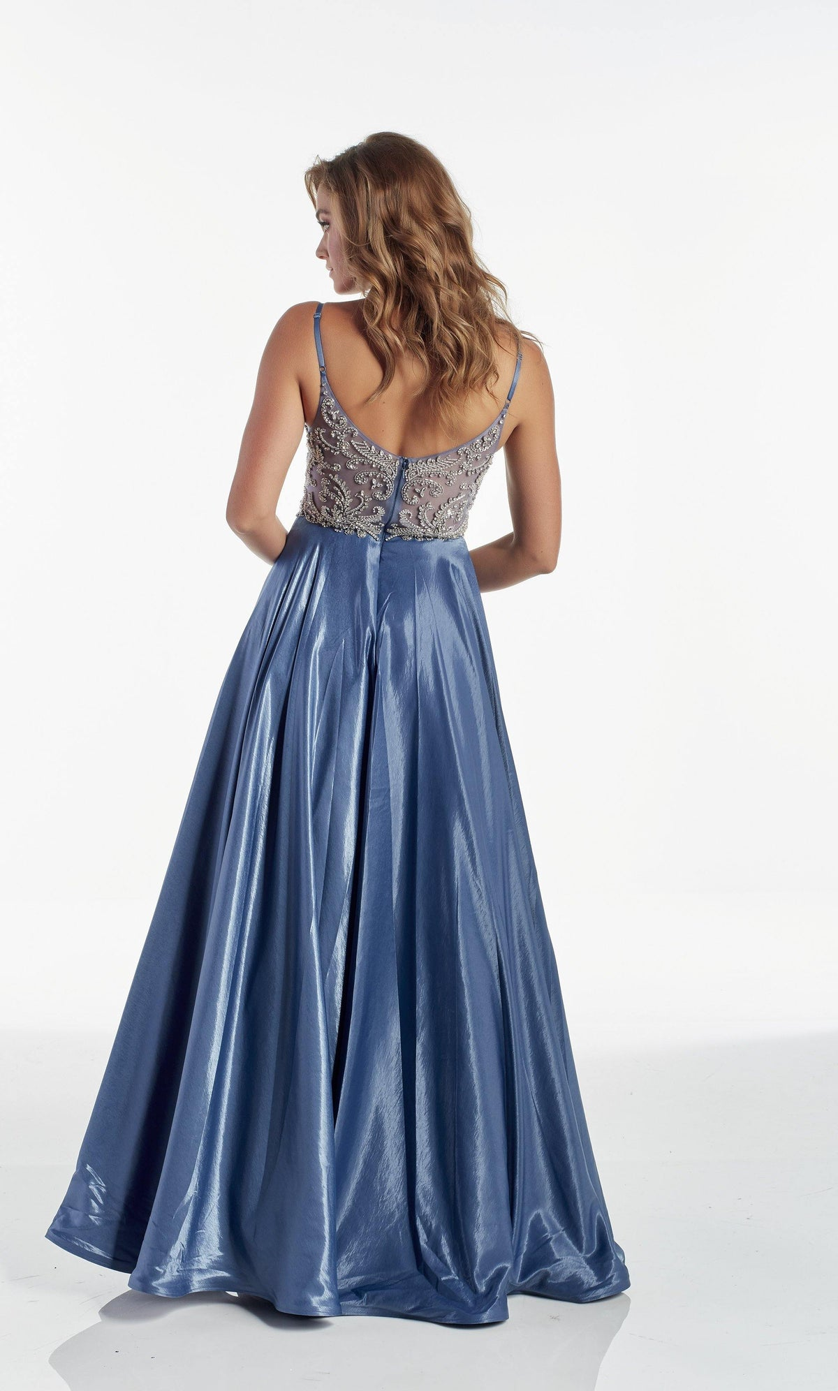 Dark French Blue flowy prom dress with an enclosed back and embellished bodice