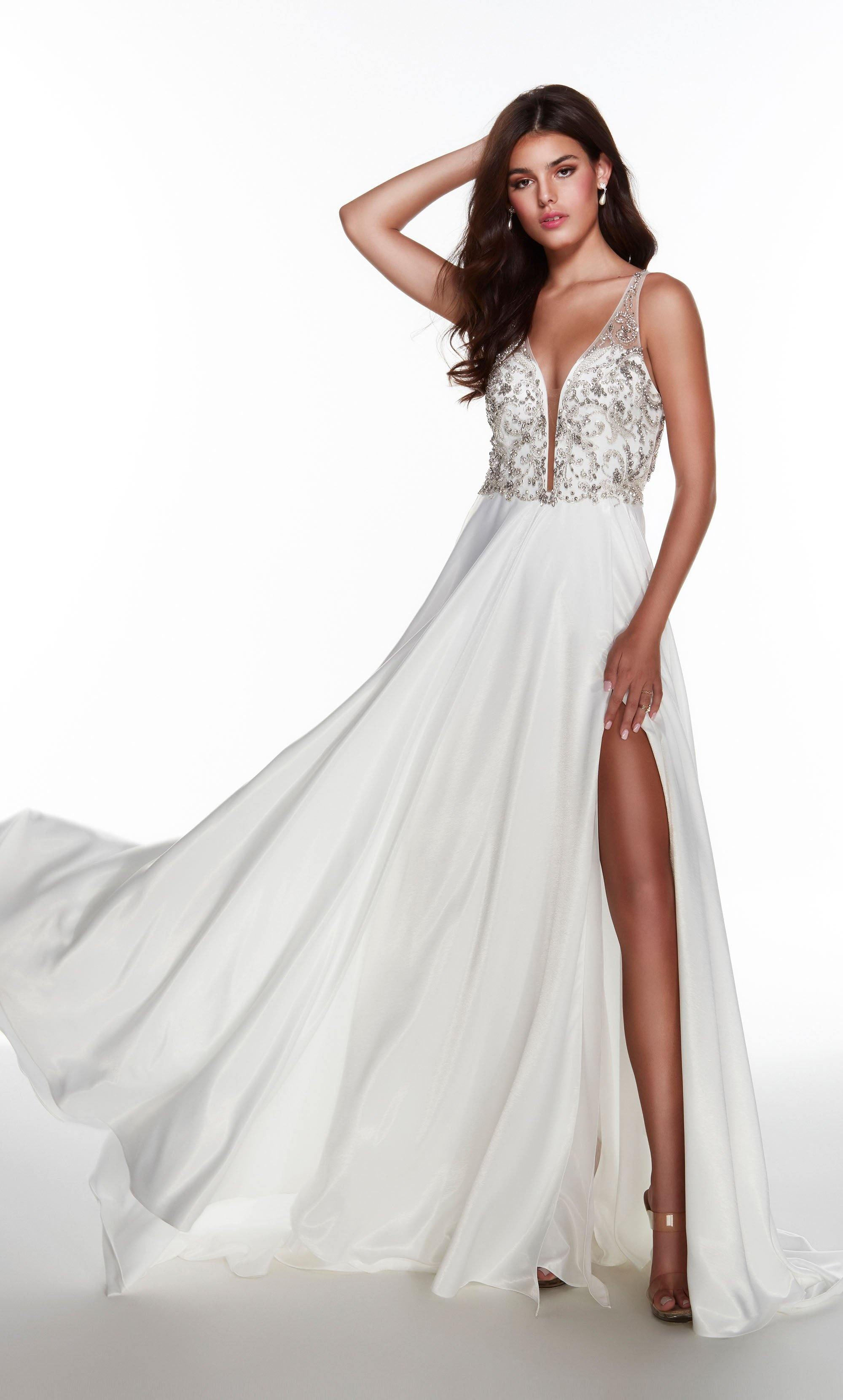 Diamond White flowy informal bridal dress with a plunging neckline, jewel embellished bodice, and front slit
