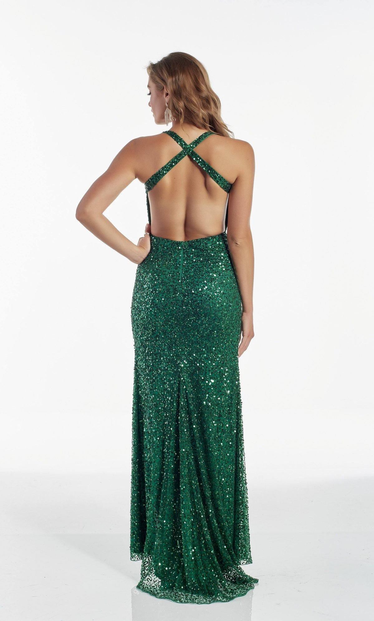 Emerald Green hand beaded prom dress with a strappy back and train