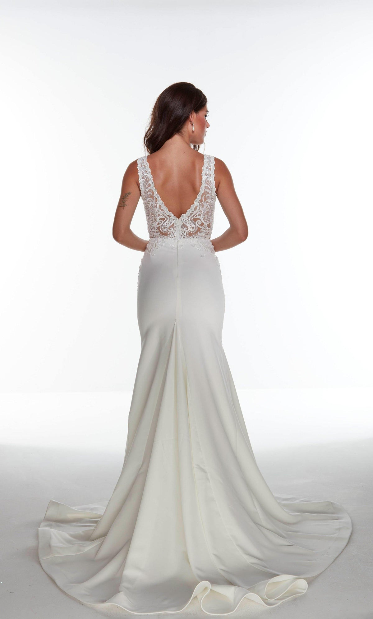 Ivory fit and flare informal bridal gown with a sheer lace bodice, V shaped back, and train
