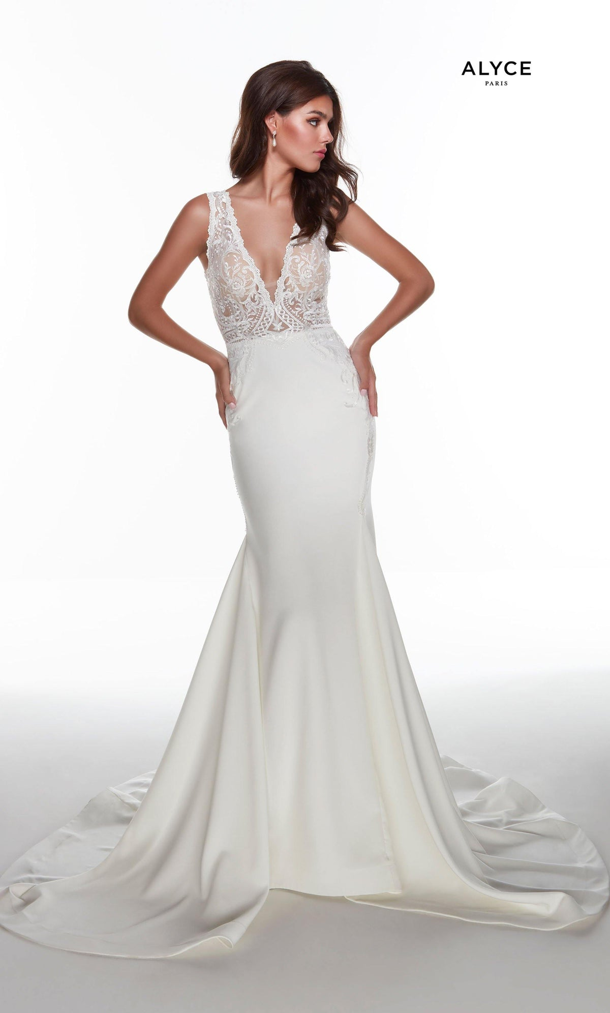 Ivory fit and flare informal bridal gown with a sheer lace bodice and plunging neckline