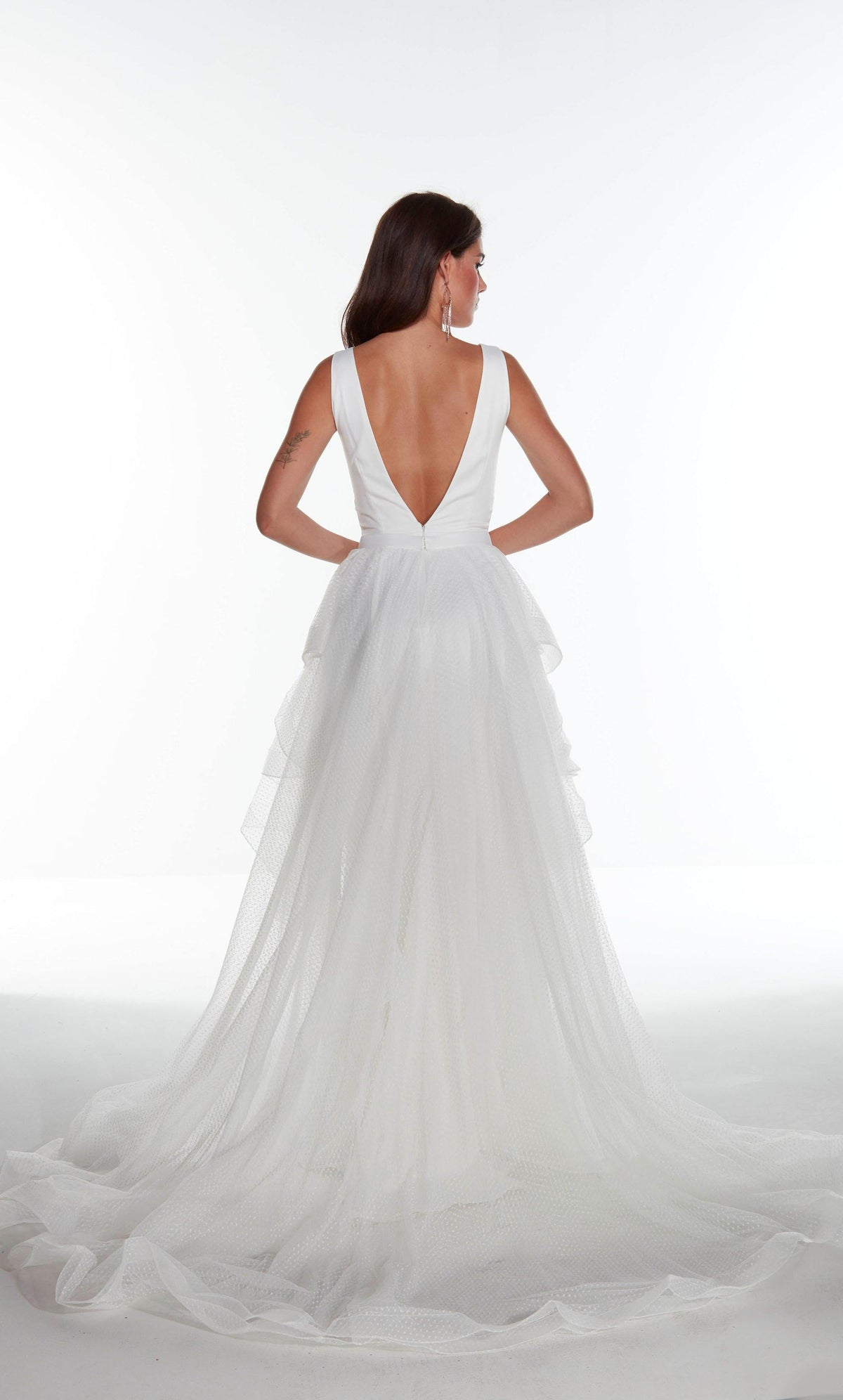 Diamond White satin informal bridal gown with a V shaped back and detachable, layered overskirt
