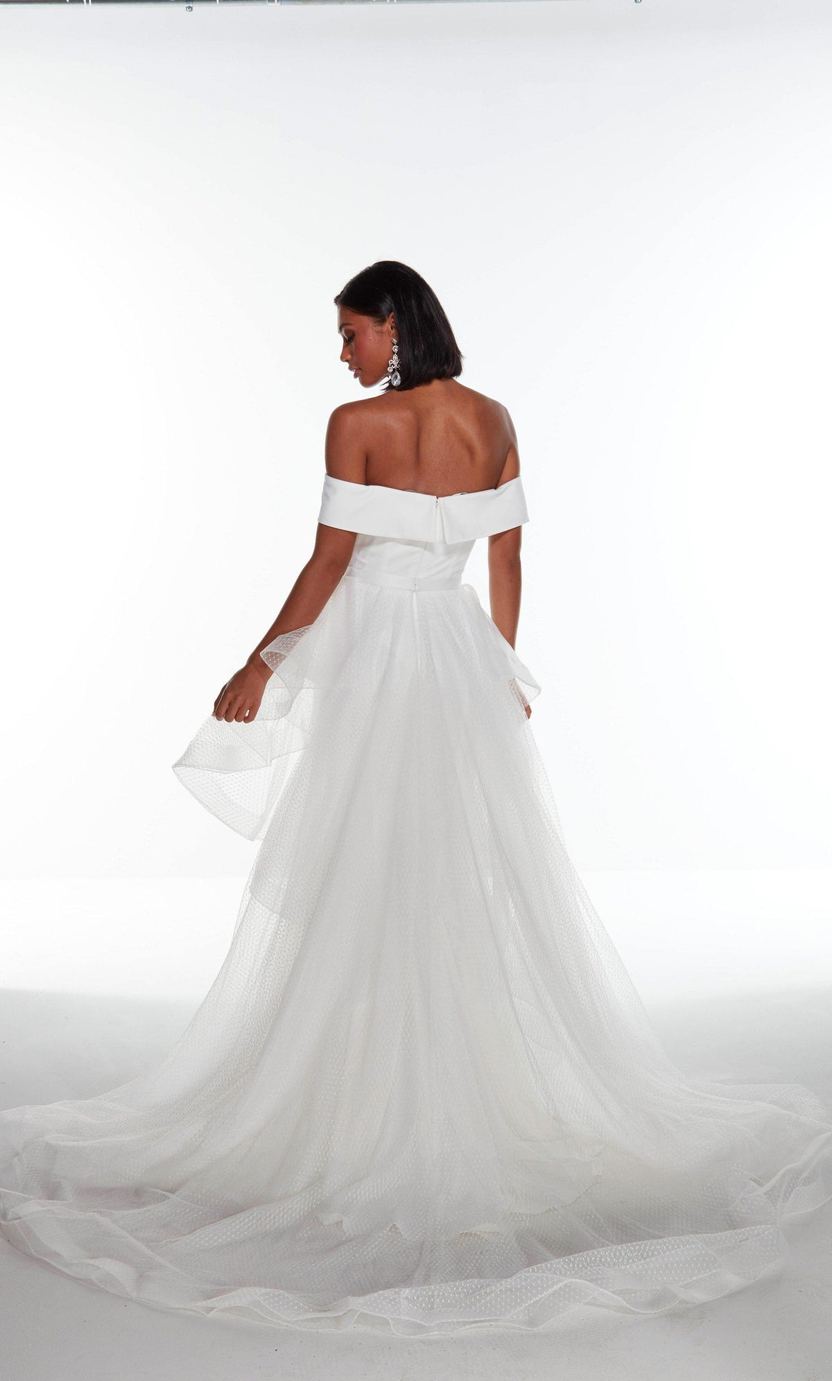 Diamond White off the shoulder satin wedding dress with an enclosed back and detachable, layered overskirt