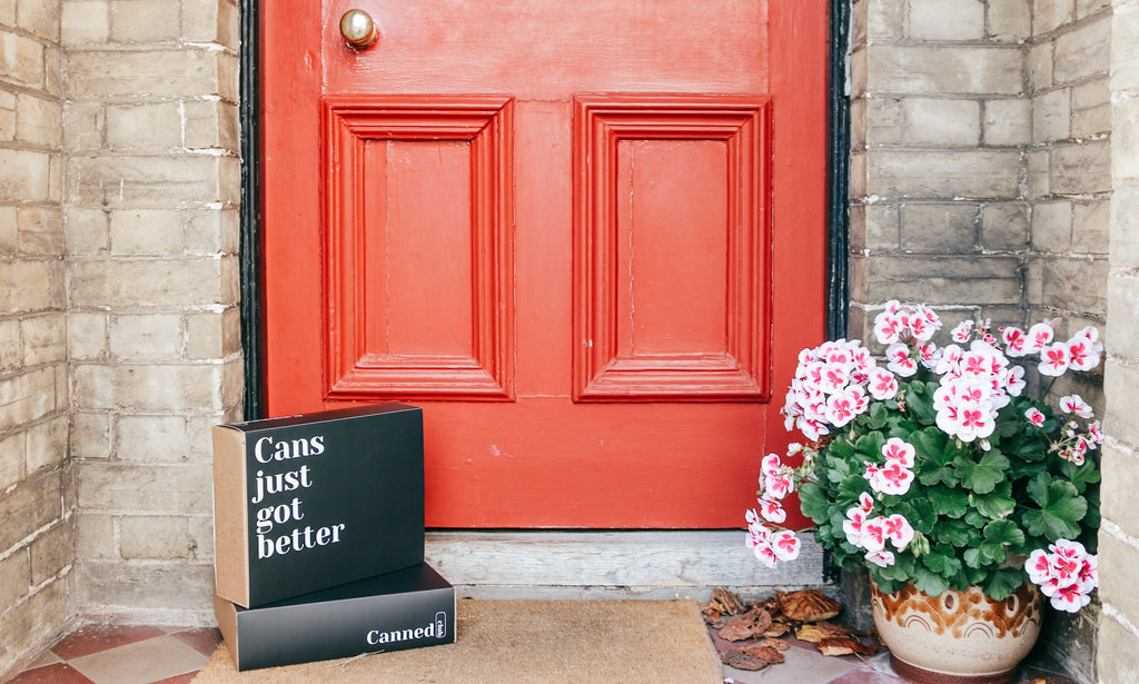 Canned club gift box on doorstep