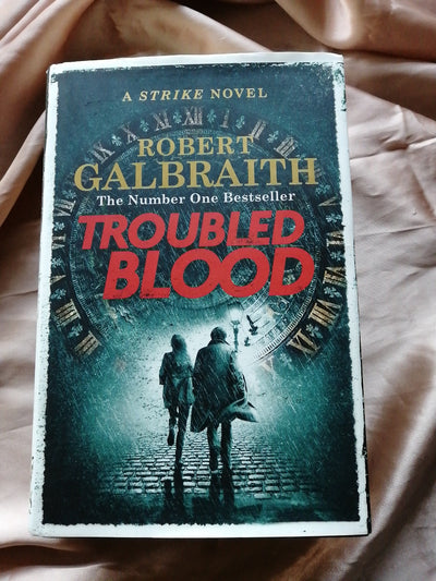 Troubled Bloos Robert Galbraith Cover